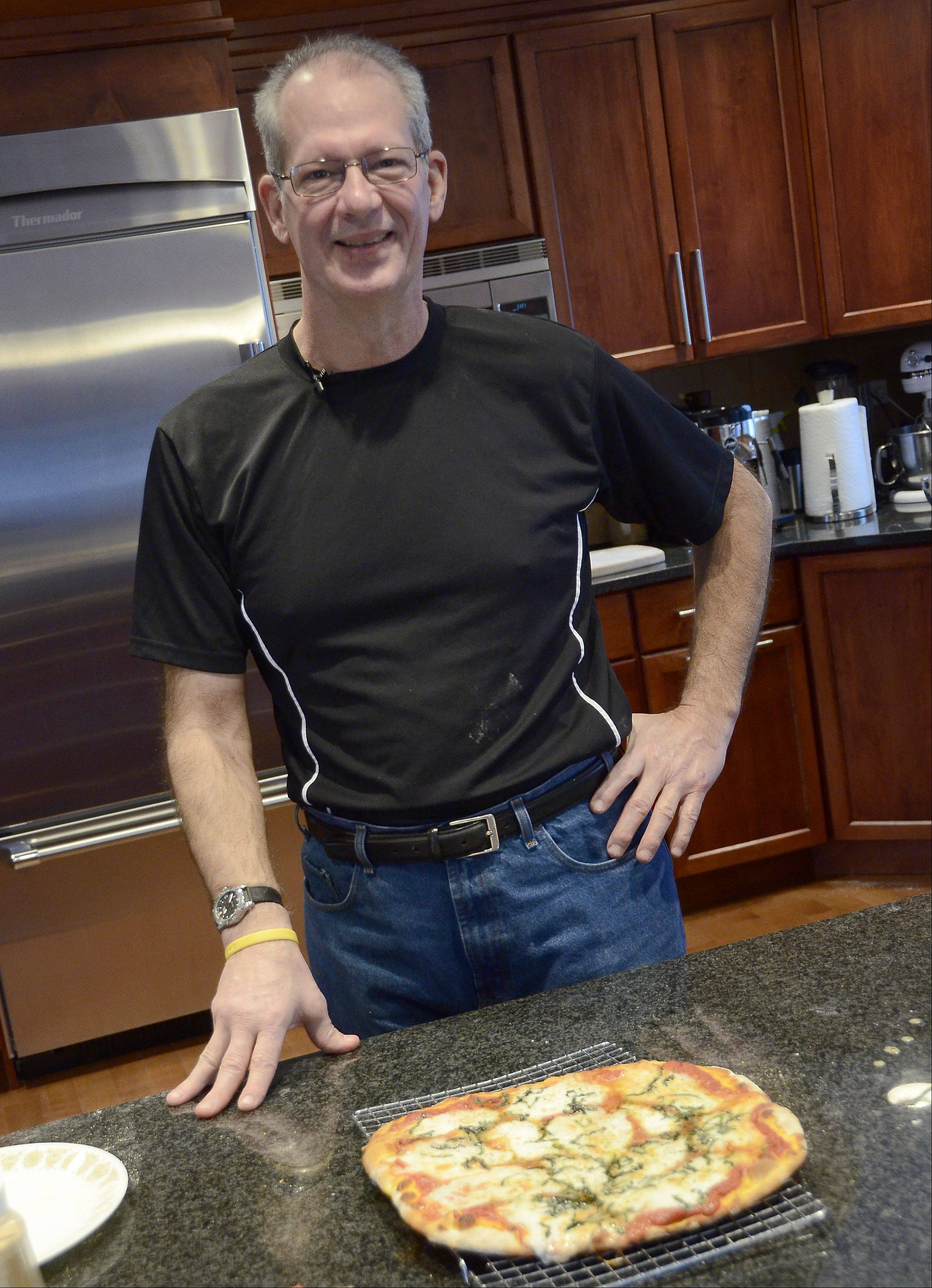 Nick Brenkus sources Italian flour and cheese for the Pizza Margherita he makes in his West Dundee home.