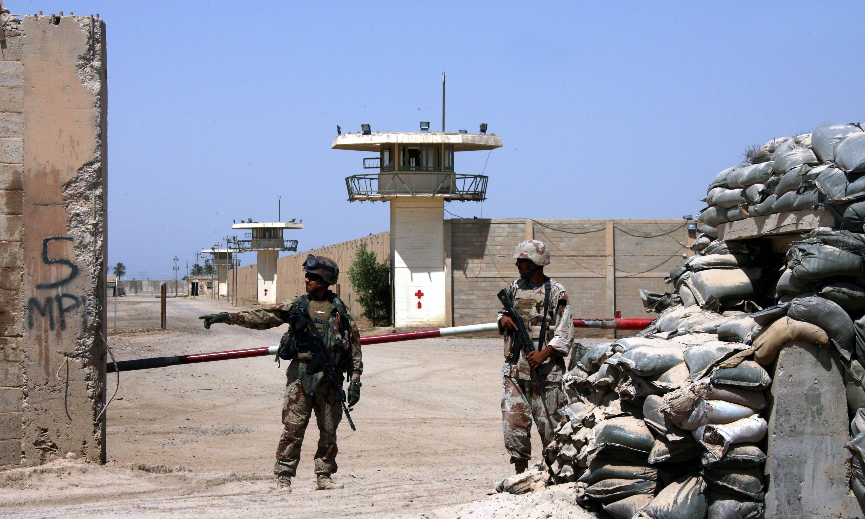 Iraqi army soldiers stand guard at the Abu Ghraib prison, after taking over from U.S. soldiers, on the outskirts of Baghdad in this file photo from 2006.
