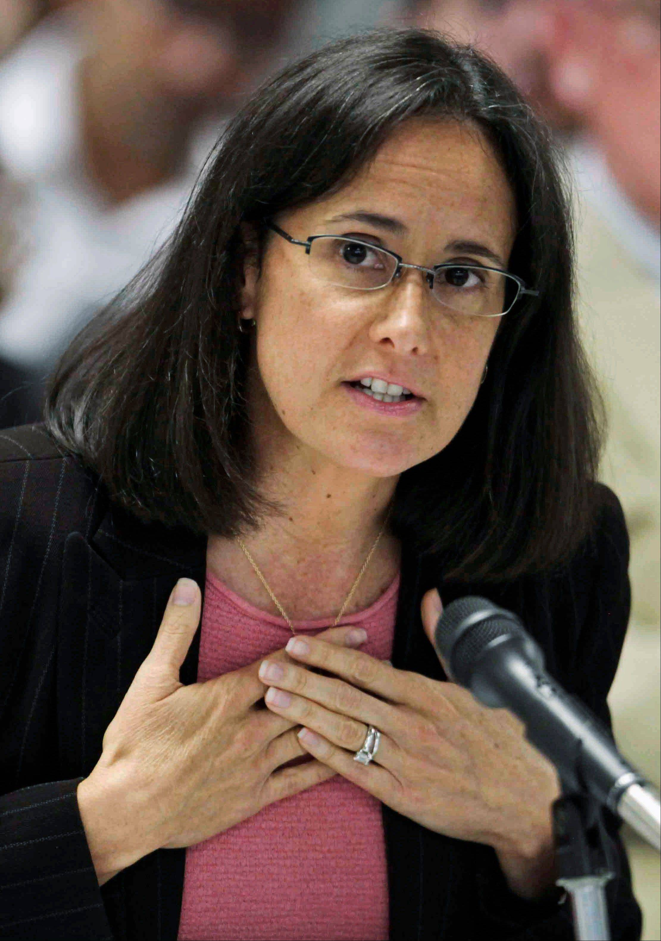 Illinois Attorney Gen. Lisa Madigan said Tuesday she filed a petition asking that all 15 judges on the U.S. 7th Circuit Court of Appeals review a lawsuit challenging the ban.
