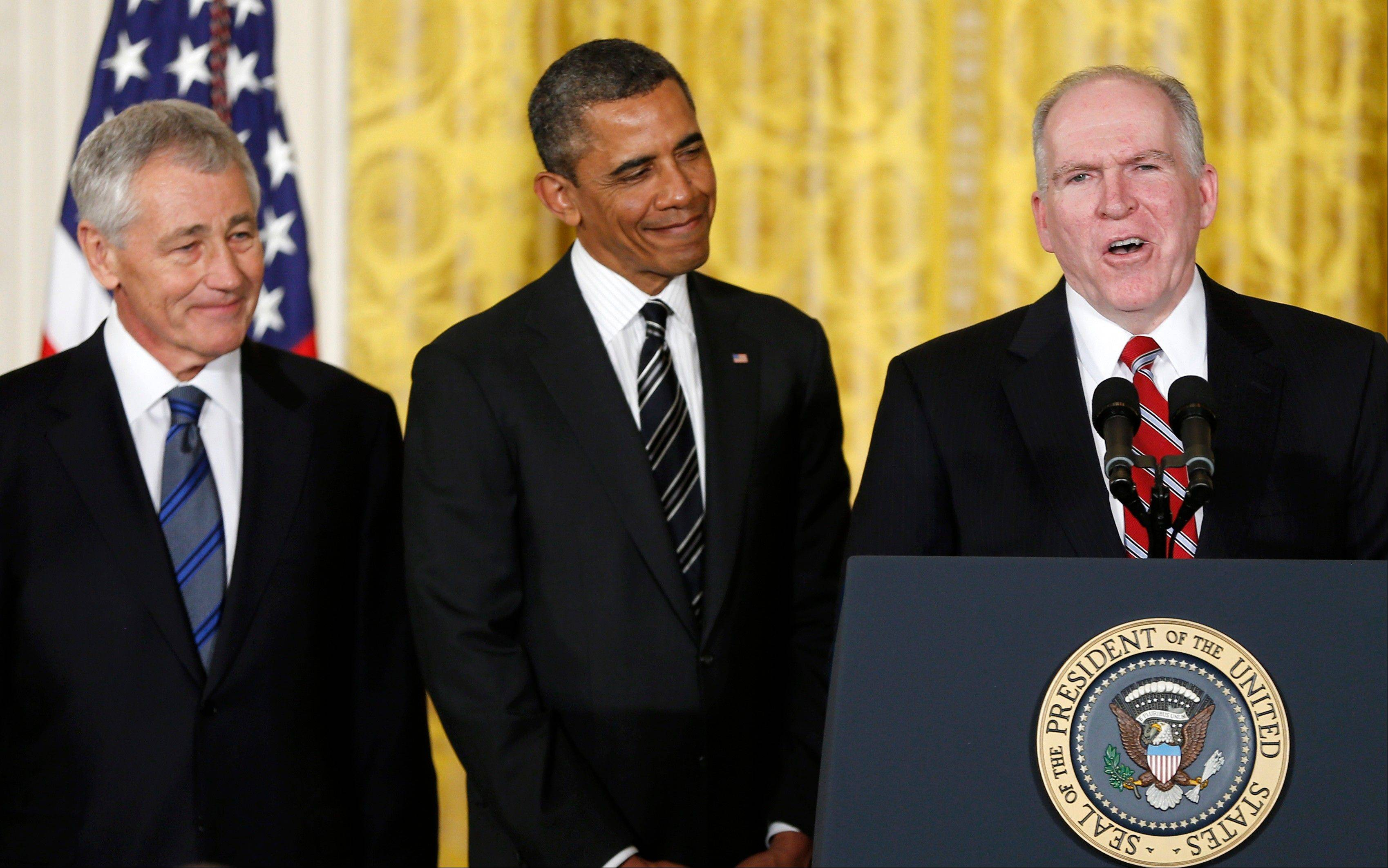 President Barack Obama and his choice for Defense Secretary, former Nebraska Sen. Chuck Hagel, left, listen as the president's choice for CIA Director, Deputy National Security Adviser for Homeland Security and Counterterrorism, John Brennan, right, speaks in the East Room of the White House in Washington, Monday, Jan. 7, 2013.