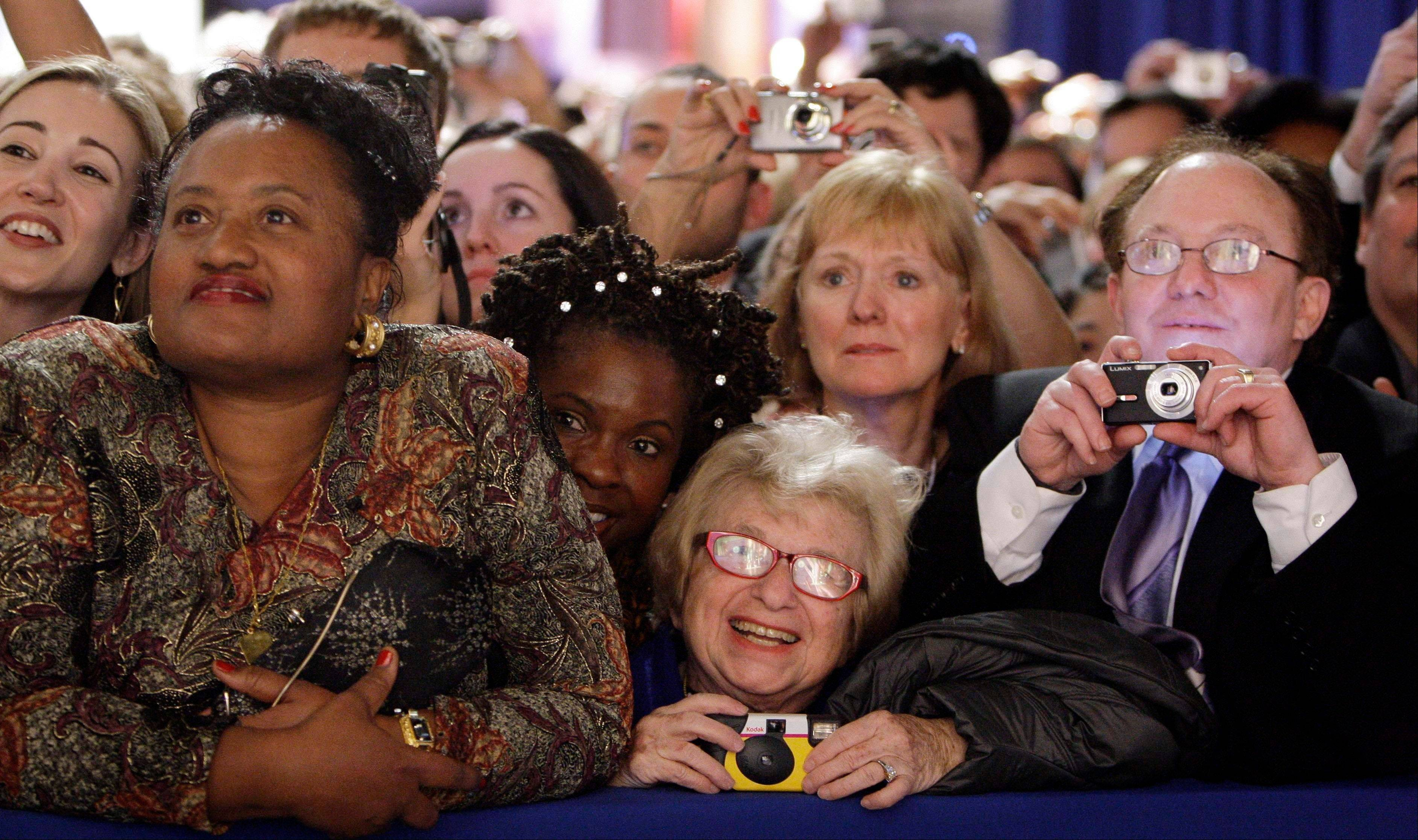 Dr. Ruth Westheimer, center, watches President Barack Obama and the first lady at an inauguration event in 2009. The sideline events throughout inauguration weekend are the big draws for advocates and lobbyists looking to rub elbows with lawmakers and administration officials. The events at restaurants and hotels, museums and mansions are opportunities for anyone willing to write a check to turn a night out into a chance to build a Rolodex of Washington's power brokers.