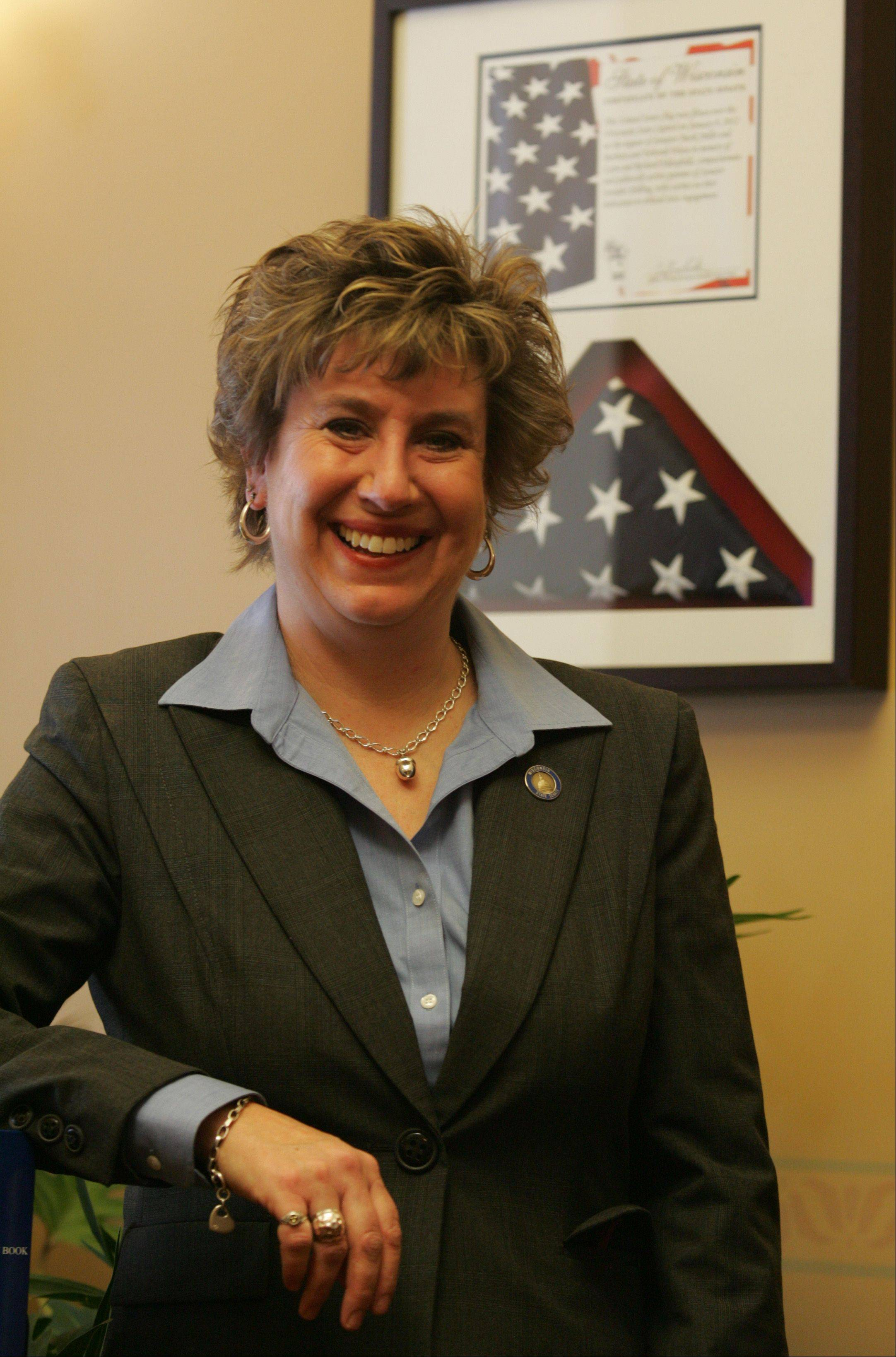 Wisconsin state Sen. Jennifer Ehlenfeldt Shilling keeps a flag in her office that was flown over the Capitol in Madison in honor of her parents, Richard and Lynn Ehlenfeldt, who were murdered 20 years ago at their Brown's Chicken & Pasta franchise in Palatine.