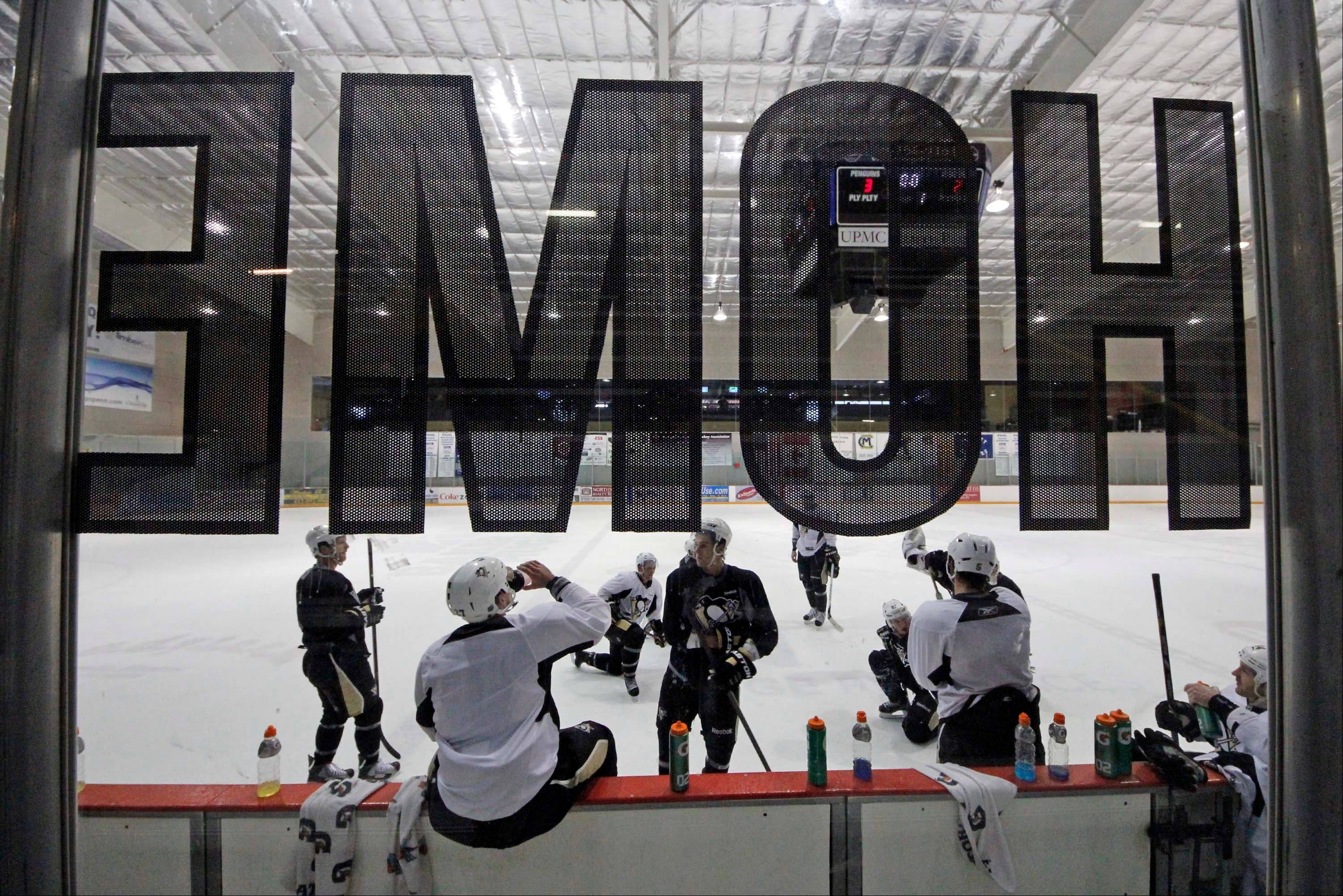 A dozen Pittsburgh Penguins players, including captain Sidney Crosby, participate in an informal workout a day after the end of the NHL labor lockout in Pittsburgh, Monday, Jan. 7, 2013.