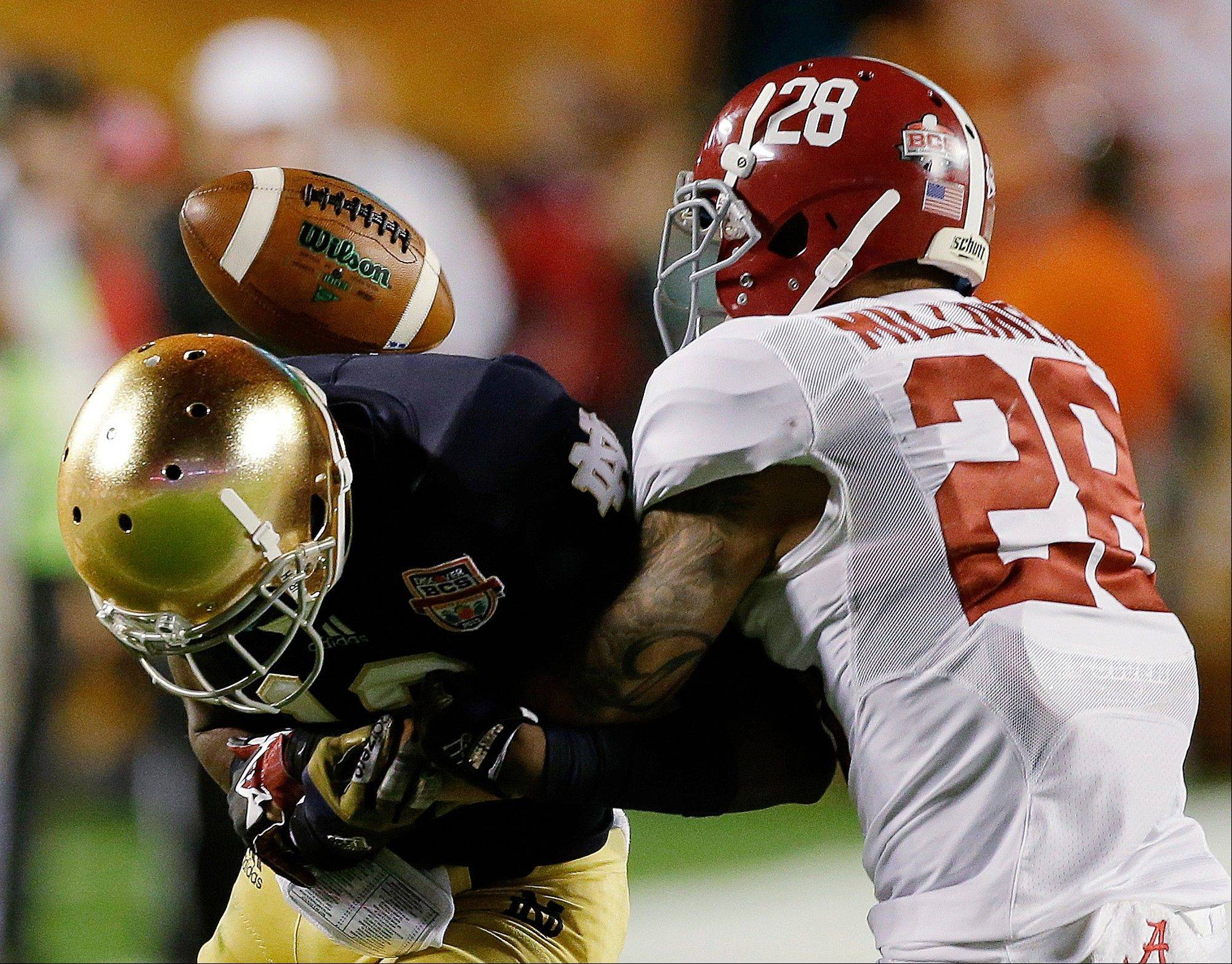 Alabama's Dee Milliner (28) breaks up a pass intended for Notre Dame's DaVaris Daniels during the first half of the BCS National Championship college football game Monday, Jan. 7, 2013, in Miami.