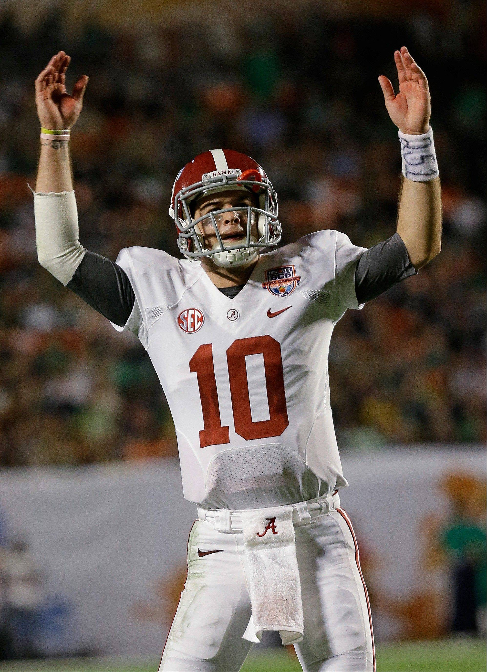 Alabama quarterback AJ McCarron celebrates during the second half of the BCS National Championship college football game against Notre Dame Monday, Jan. 7, 2013, in Miami.