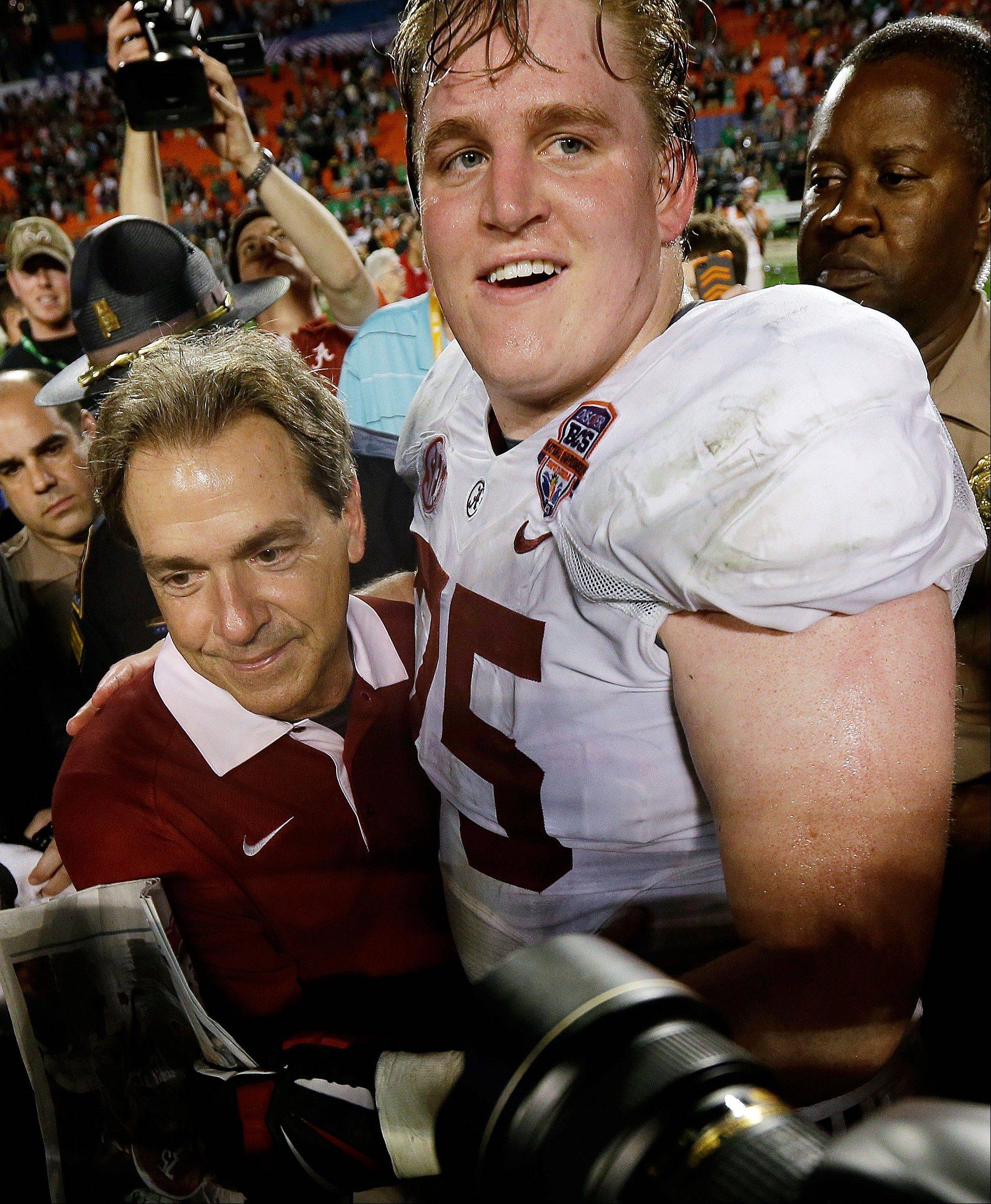 Alabama head coach Nick Saban celebrates with Barrett Jones after the BCS National Championship college football game against Notre Dame Monday, Jan. 7, 2013, in Miami. Alabama won 42-14.