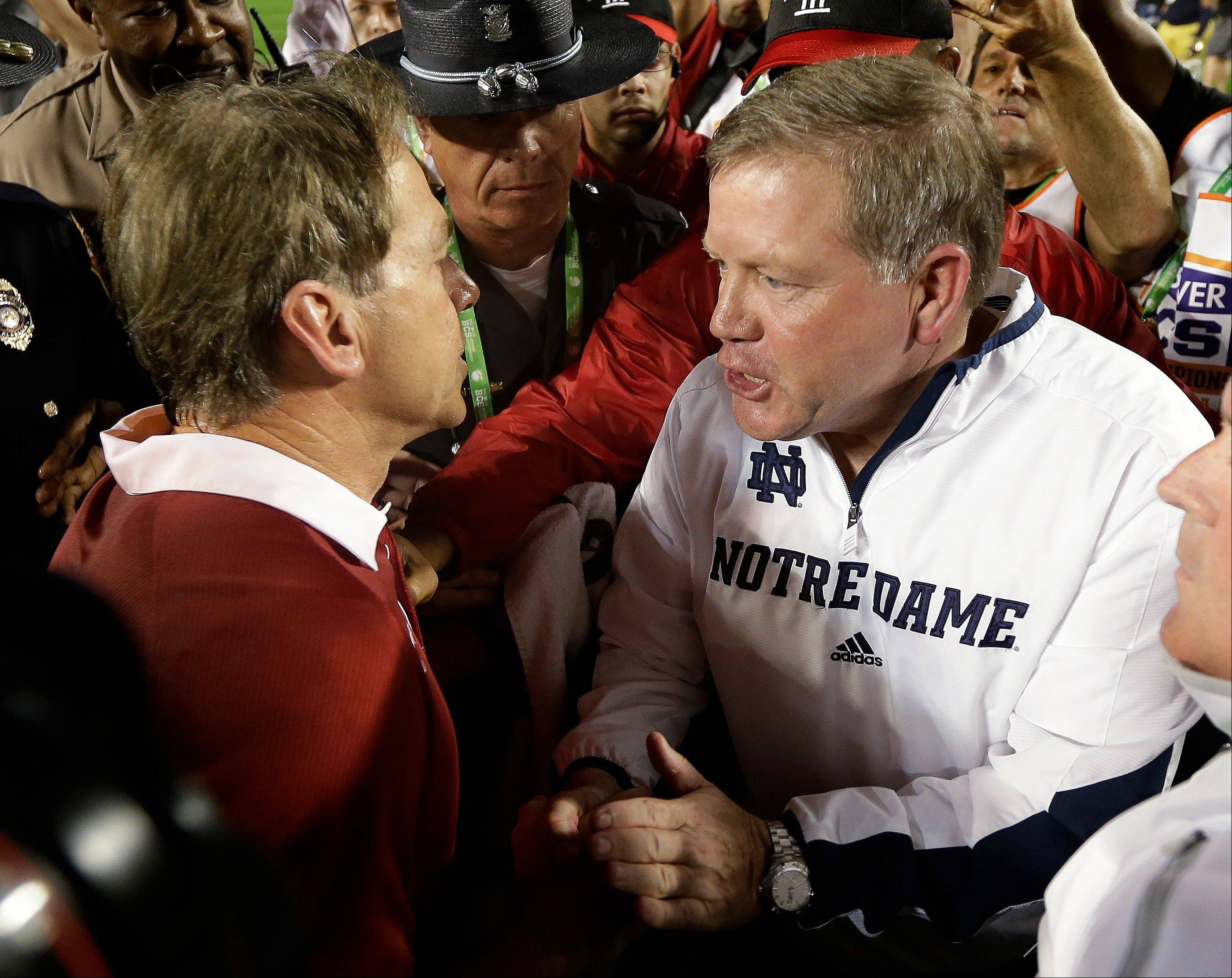 Alabama head coach Nick Saban shakes hands with Notre Dame head coach Brian Kelly after the BCS National Championship college football game Monday, Jan. 7, 2013, in Miami. Alabama won 42-14.