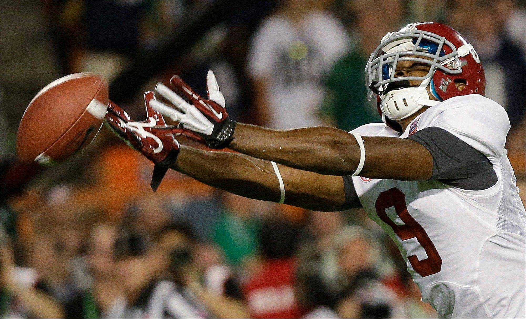 Alabama wide receiver Amari Cooper can't quite come up with a reception during the first half of the BCS National Championship college football game against Notre Dame Monday, Jan. 7, 2013, in Miami.