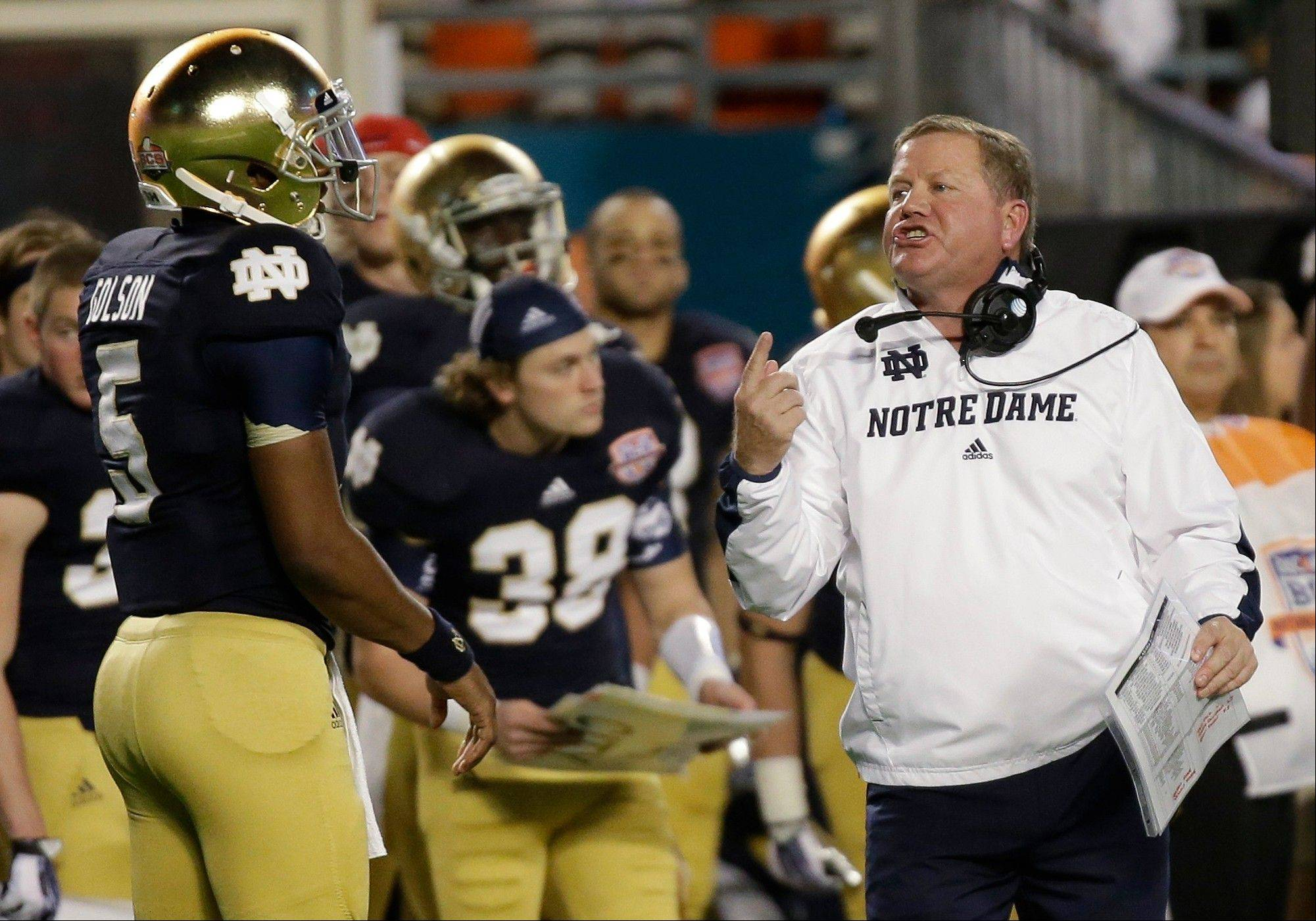 Notre Dame head coach Brian Kelly talks to Everett Golson during the first half of the BCS National Championship college football game against Alabama Monday, Jan. 7, 2013, in Miami.
