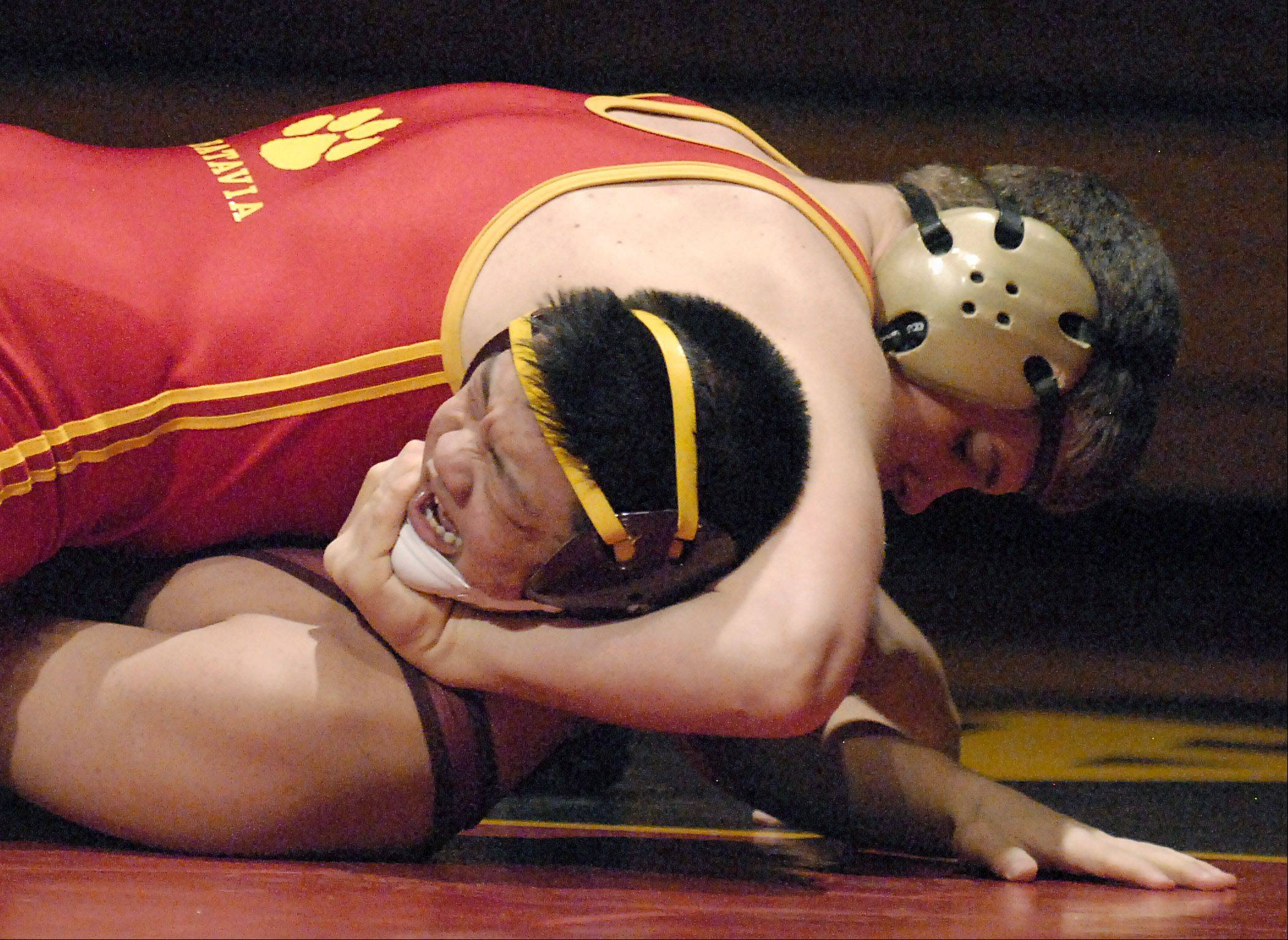 Batavia's Nick Whittman takes the 170-pound over Schaumburg's Woo Lee on Saturday.