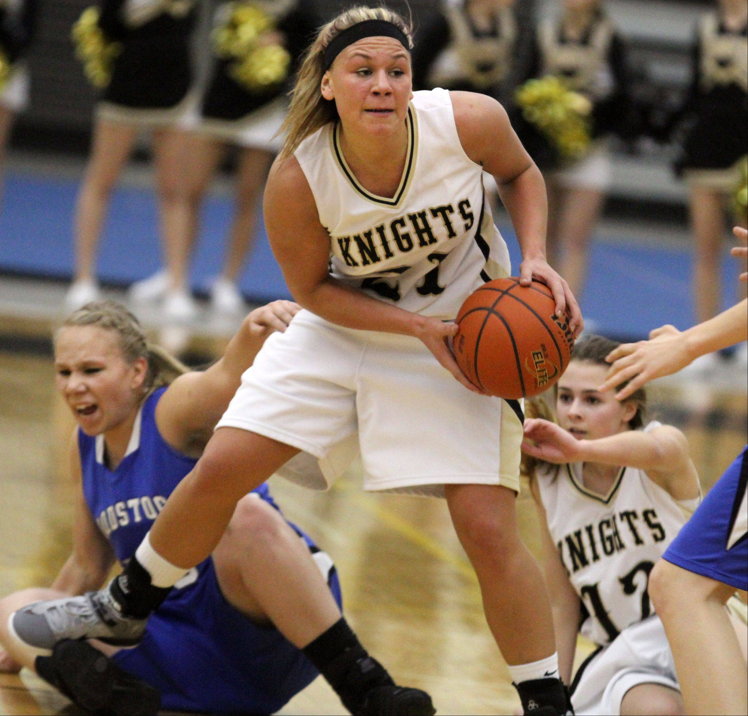 Grayslake North's Shyanne Ludwick looks to pass after picking up a loose ball against Woodstock in Grayslake on Friday.