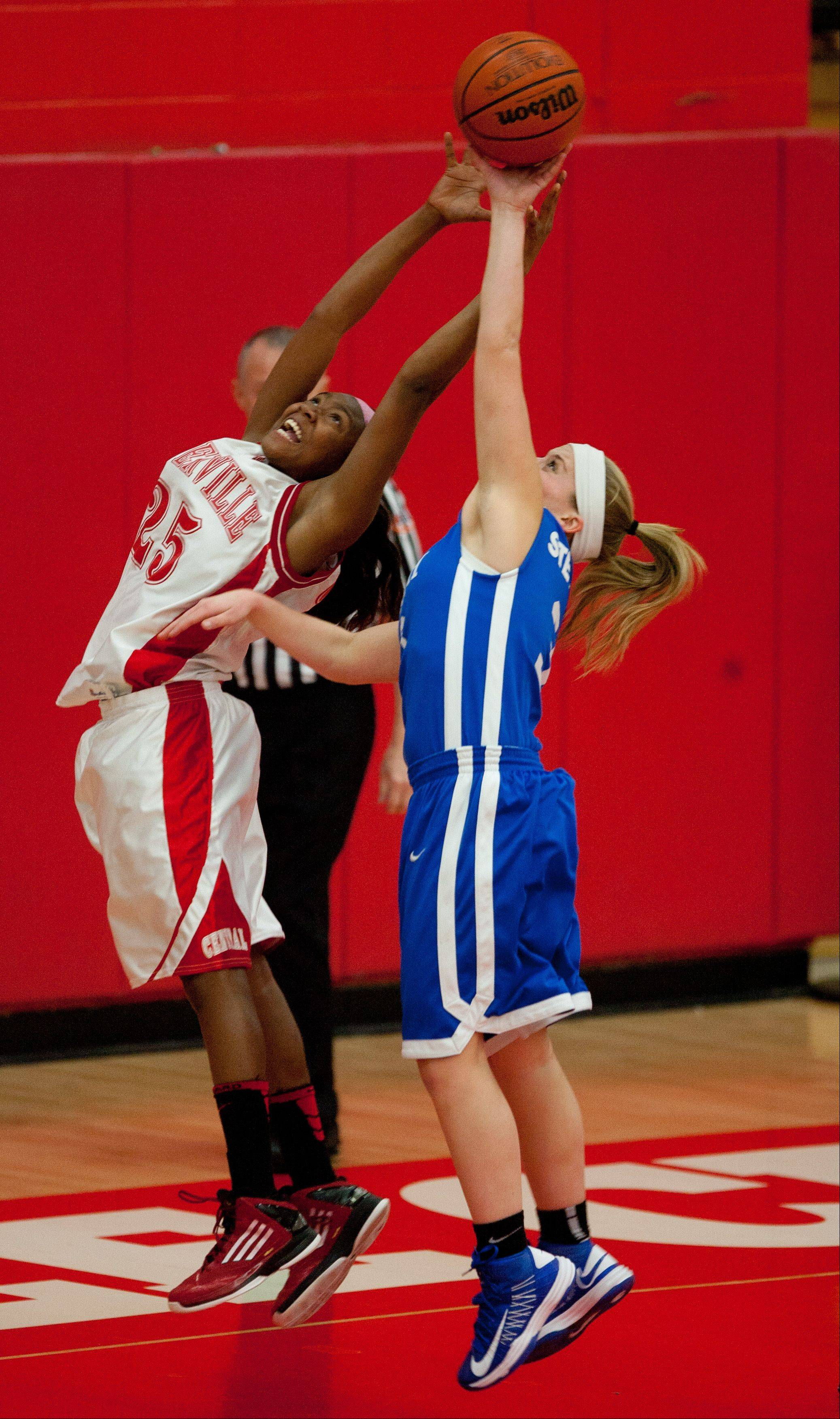 Naperville Central's Cierra Stanciel, left, looks to rebound over Wheaton North during Saturday's game in Naperville.