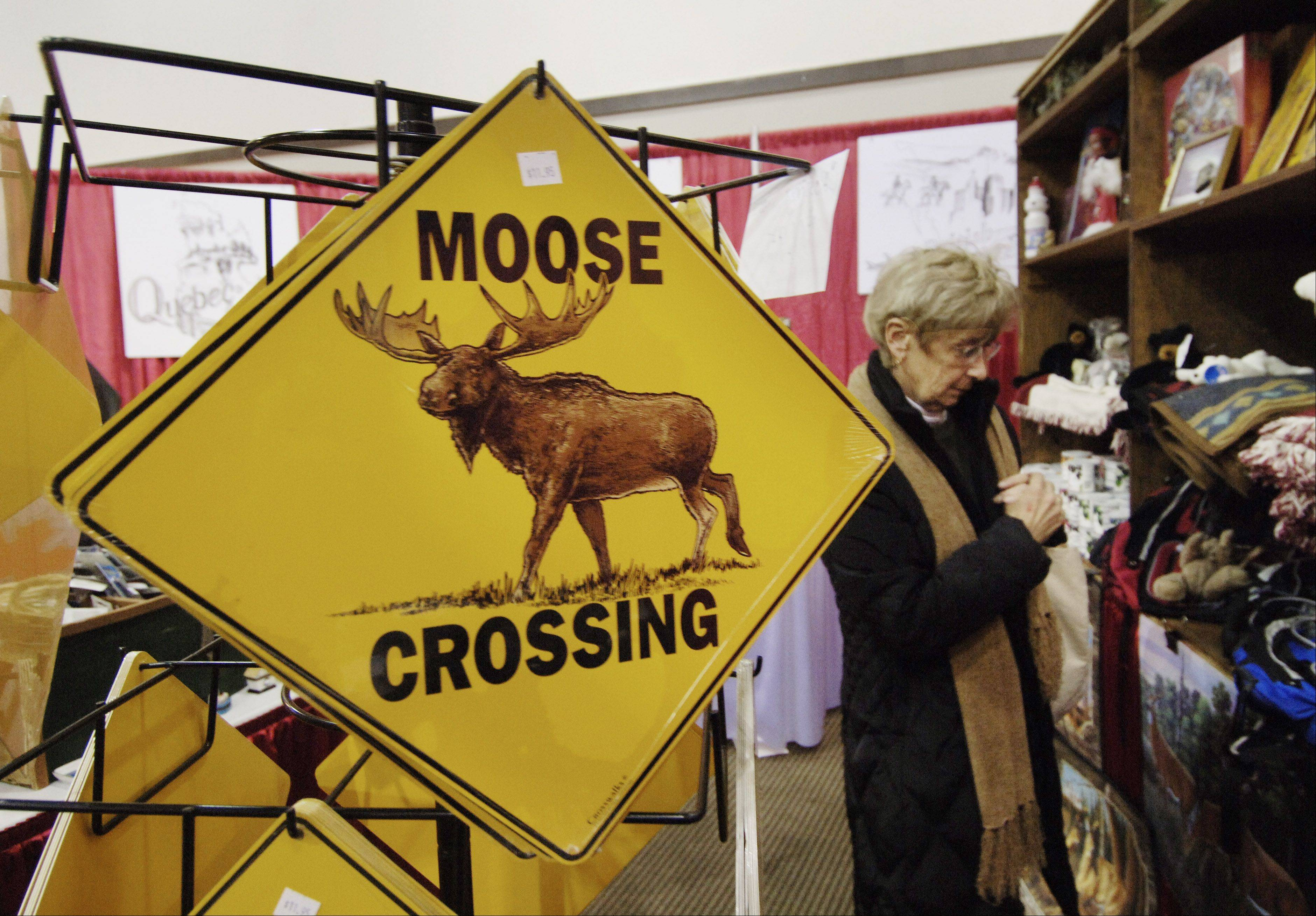 Barbara Bradley of Wheaton browses in the Moose Bay Trading Company at a previous All-Canada Show at the Pheasant Run Mega Center in St. Charles. The show offers visitors opportunities to gather information and book vacations to Canada. The show runs Thursday, Jan. 10, to Sunday, Jan. 13.