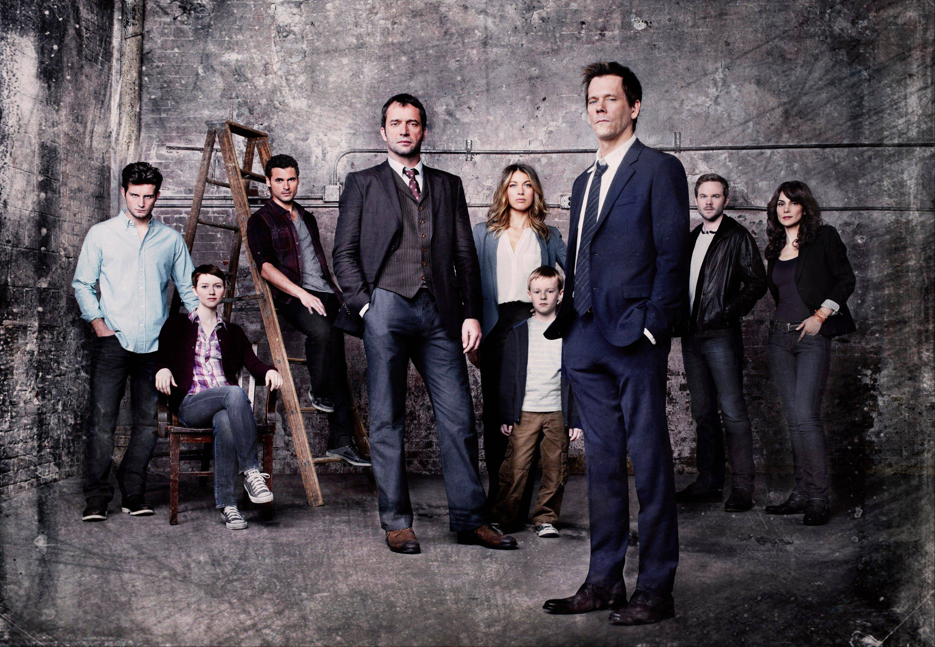 Kevin Bacon, front right, plays former FBI agent Ryan Hardy, who is called out of retirement to track down James Purefoy, fourth from left, as Joe Carroll, in the new psychological thriller �The Following� on Fox. The rest of the cast includes, from rear left, Nico Tortorella, Valorie Curry, Adan Canto, Natalie Zea, Kyle Catlett, Shawn Ashmore and Annie Parisse.