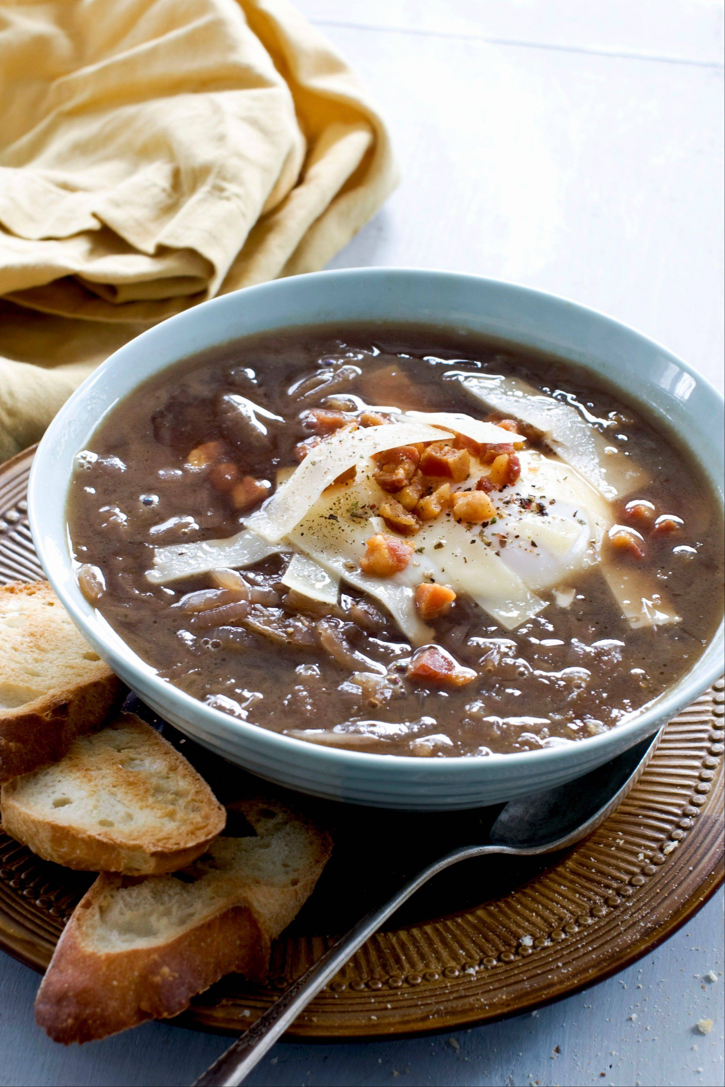 Can French onion soup still be rich without its blanket of broiled cheese? A poached egg on top makes the answer a definitive �yes.�