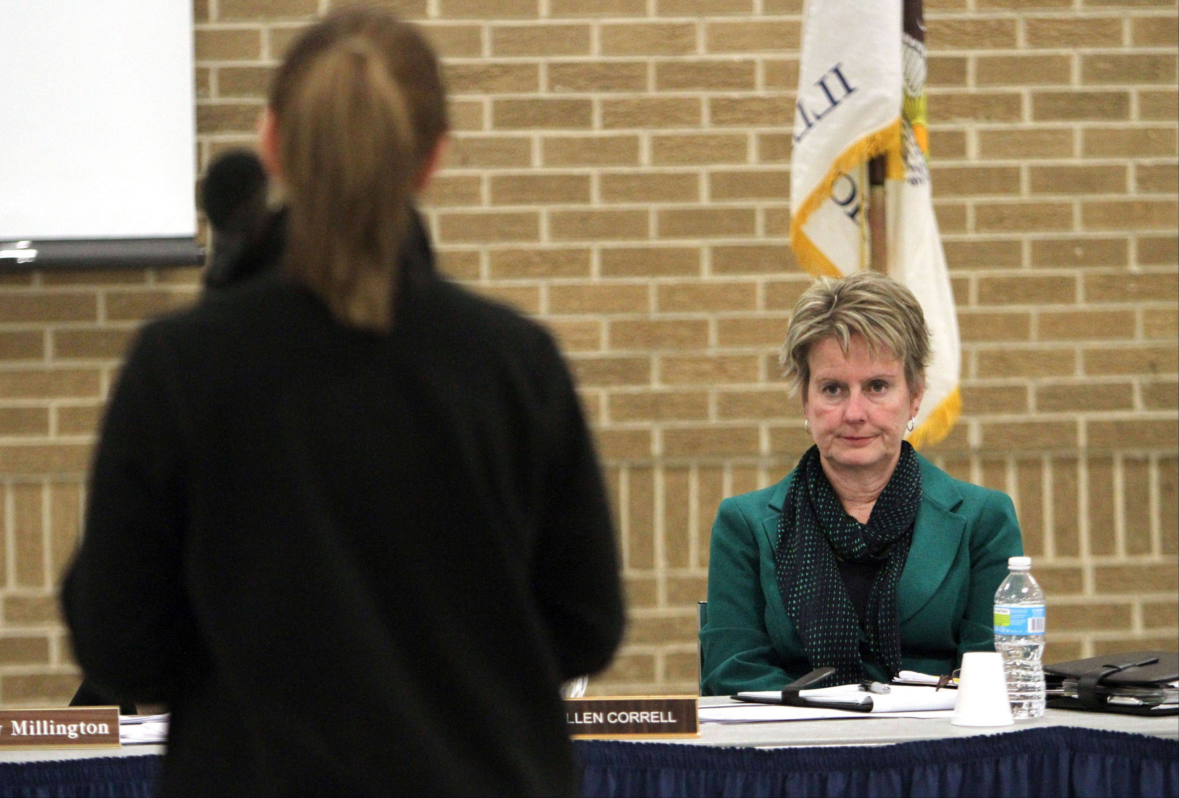 Grayslake Elementary District 46 Superintendent Ellen Correll listens to public comments as board members hosted a town-hall meeting Wednesday night to focus on questions from parents and others related to a possible teachers strike.