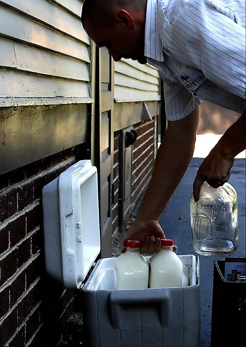 An Oberweis Dairy milk deliveryman makes his rounds in Batavia. On Jan. 4, someone stole milk, orange juice and water out of delivery coolers at 11 homes in Geneva.