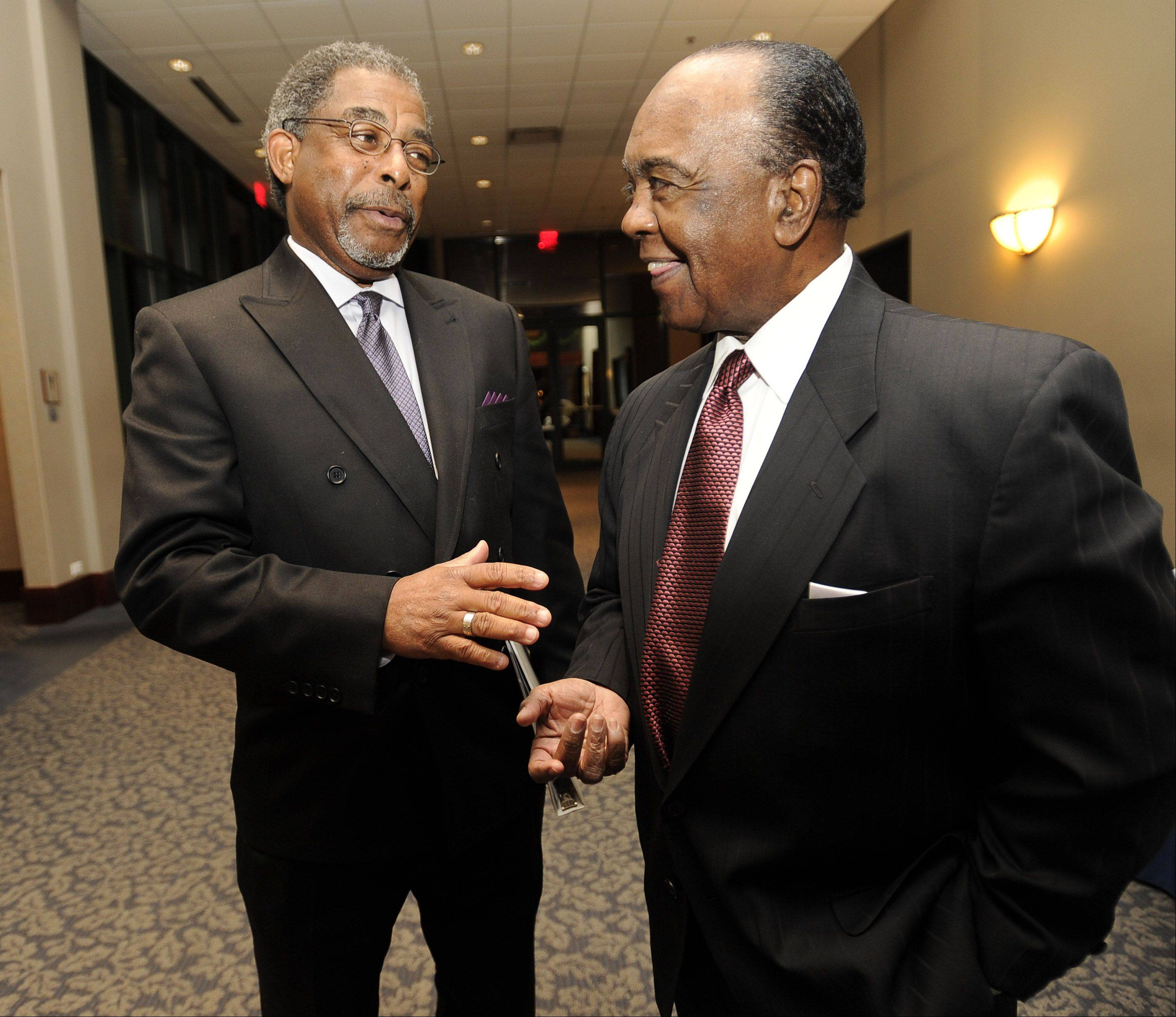 The Rev. Nathaniel Edmond, pastor of the Second Baptist Church of Elgin, left, speaks with the Rev. Clyde Brooks at last year's suburban celebration of the life, work and birthday of Martin Luther King.