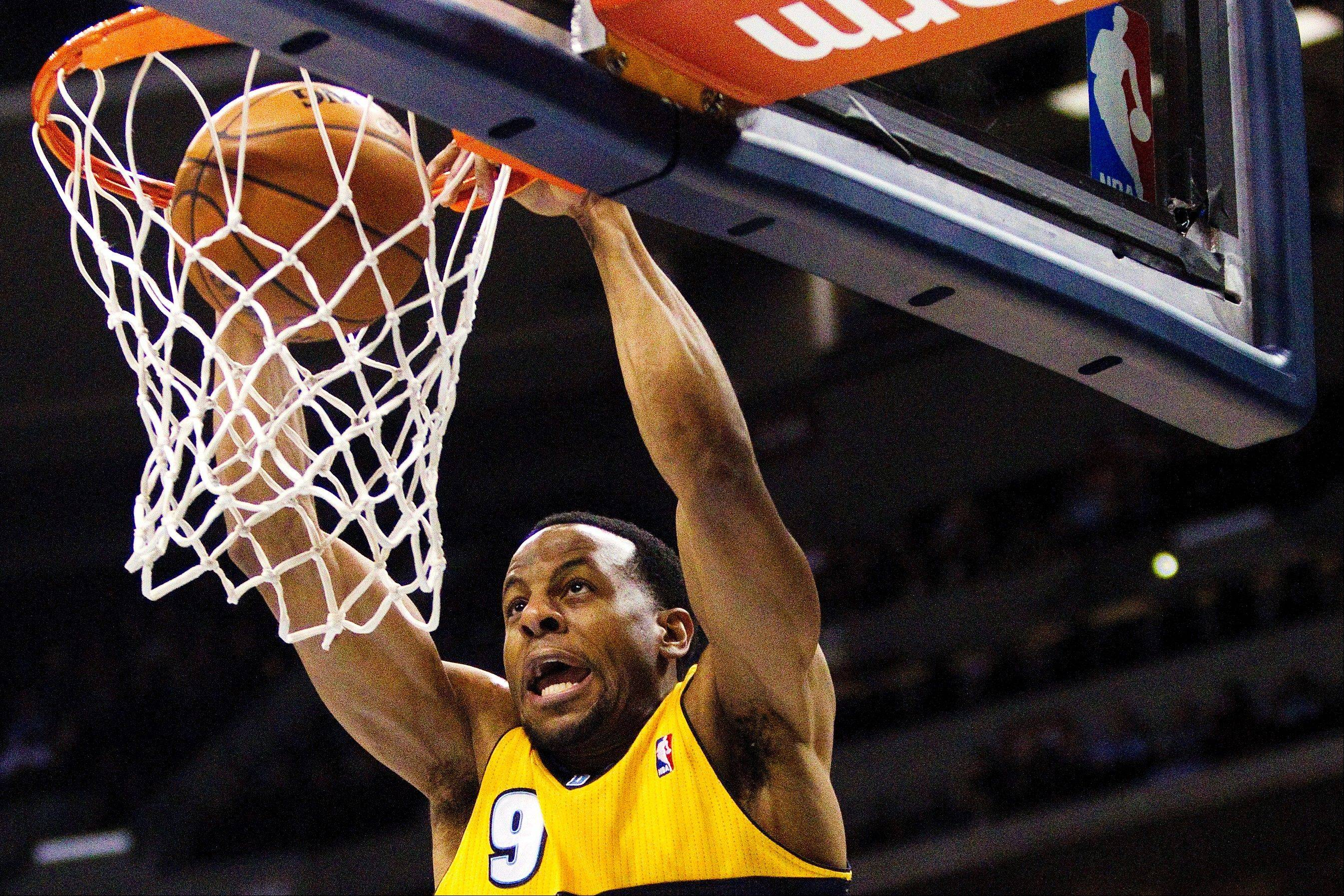 Denver Nuggets� Andre Iguodala (9) dunks off an alley-oop during the first quarter of an NBA basketball game against the Orlando Magic on Wednesday in Denver.
