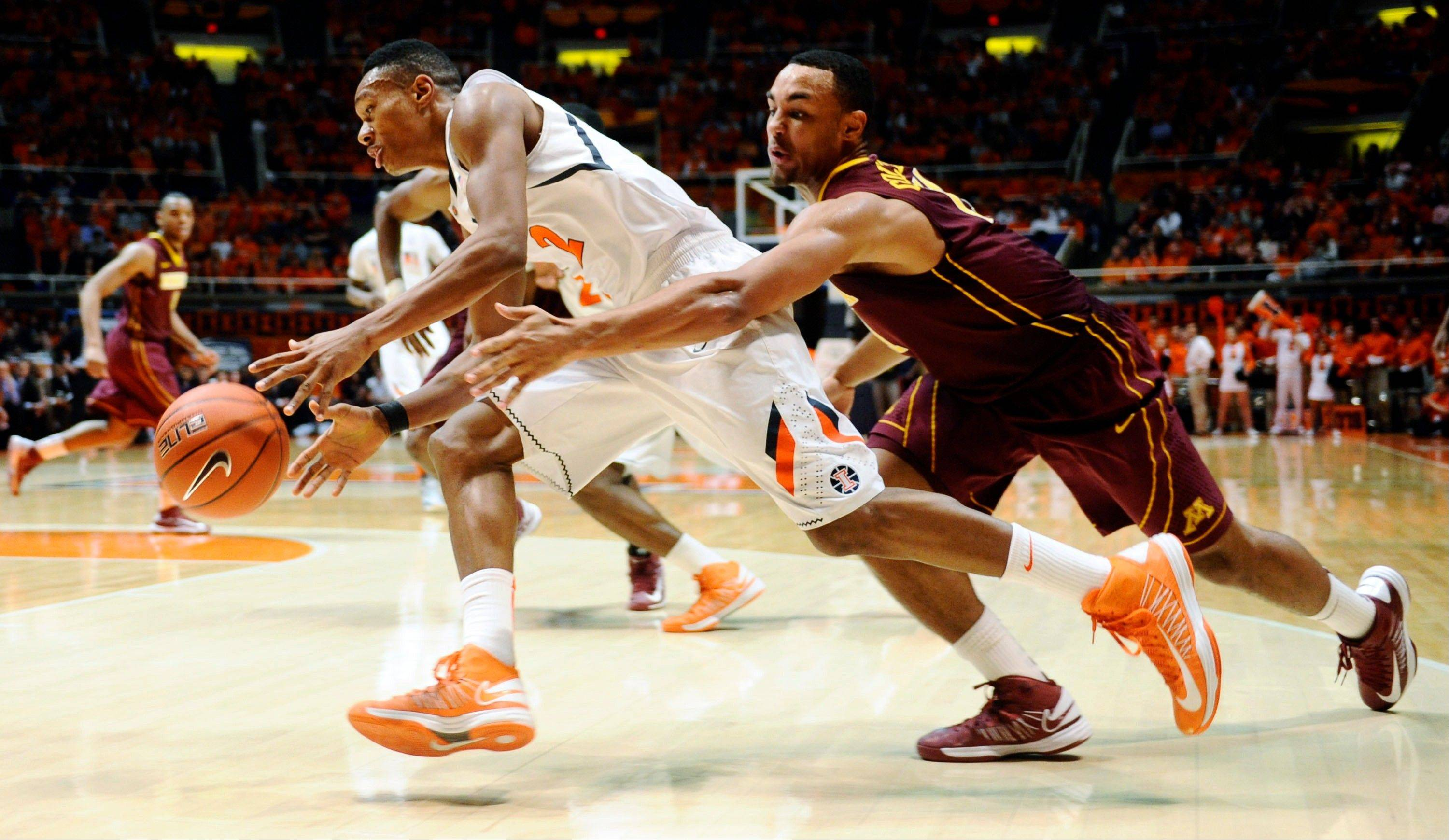 Illinois guard Joseph Bertrand (2) drives under pressure from Minnesota guard Joe Coleman (11) during their NCAA college basketball game Wednesday in Champaign, Ill.