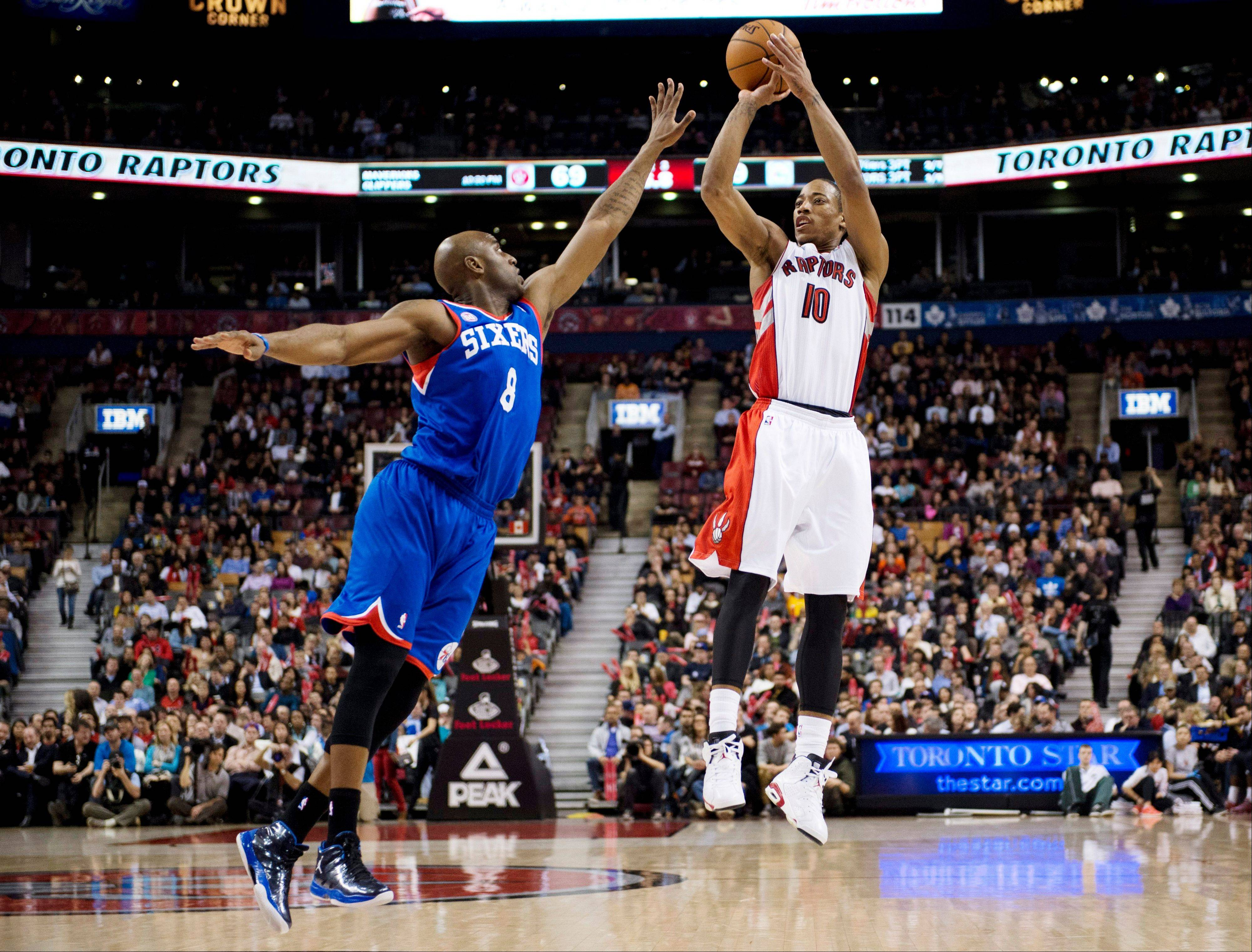 Toronto Raptors guard DeMar DeRozan (10) shoots as Philadelphia 76ers guard Damien Wilkins (8) tries to block during the second half of their NBA basketball game Wednesday in Toronto. The Raptors won 90-72.