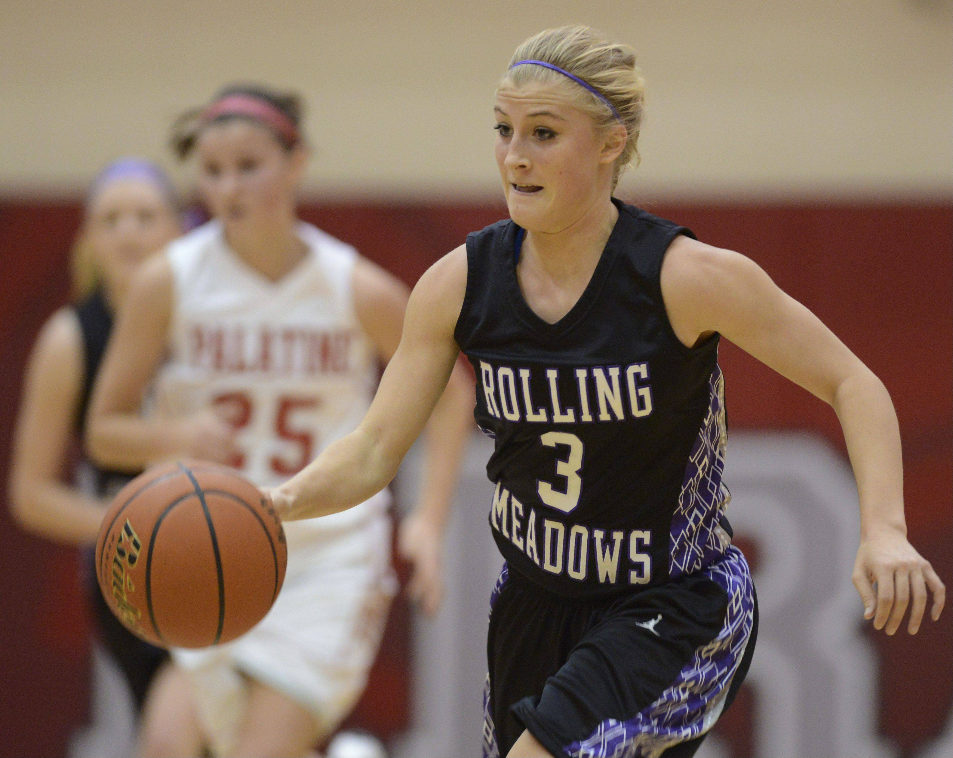 Rolling Meadows� Jackie Kemph leads a fast break against Palatine.