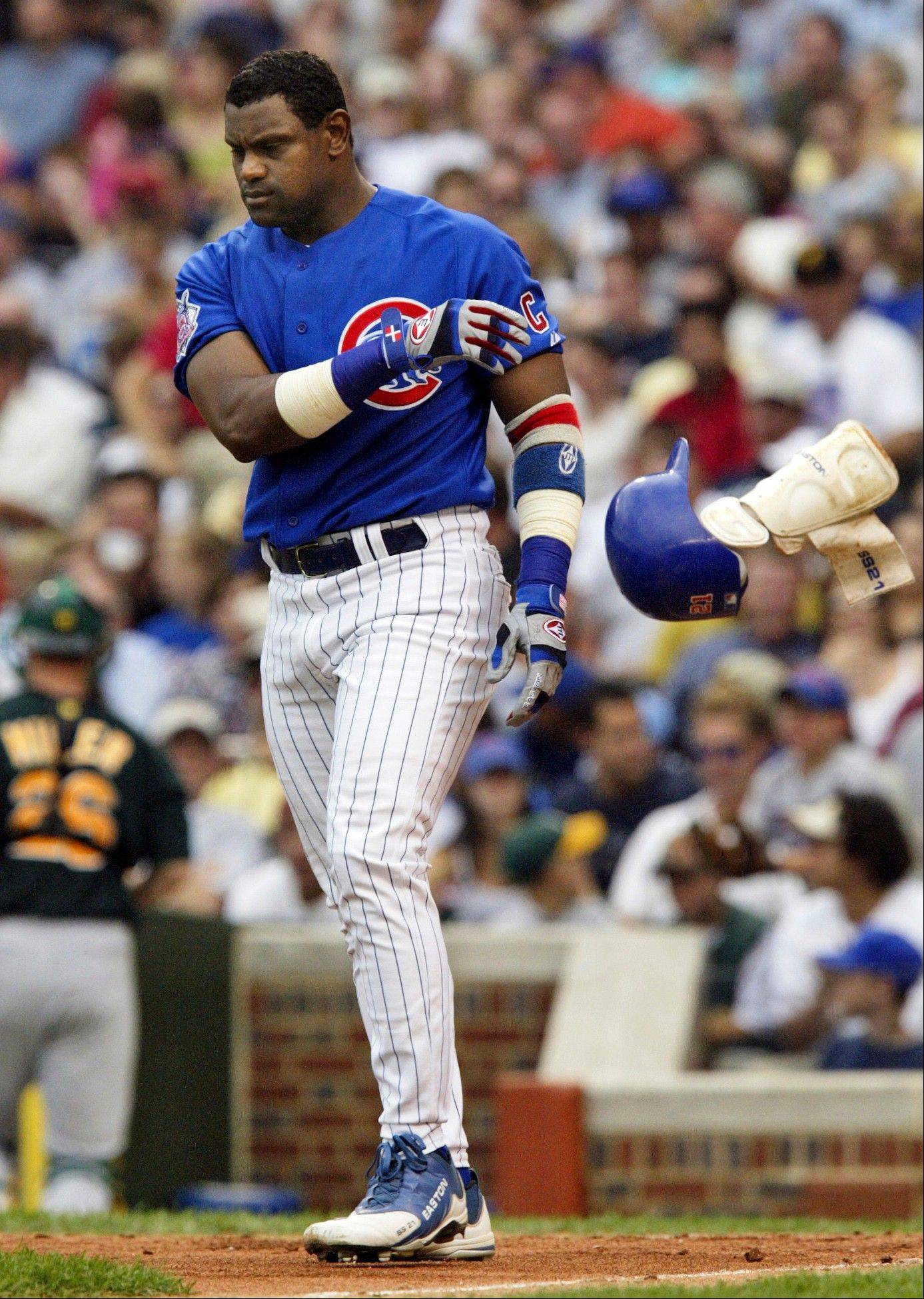 In this June 18, 2004, file photo, the Cubs� Sammy Sosa tosses his helmet and shin guard after striking out. Sosa was on only 12.5 percent of the ballots cast for this year�s Hall of Fame.