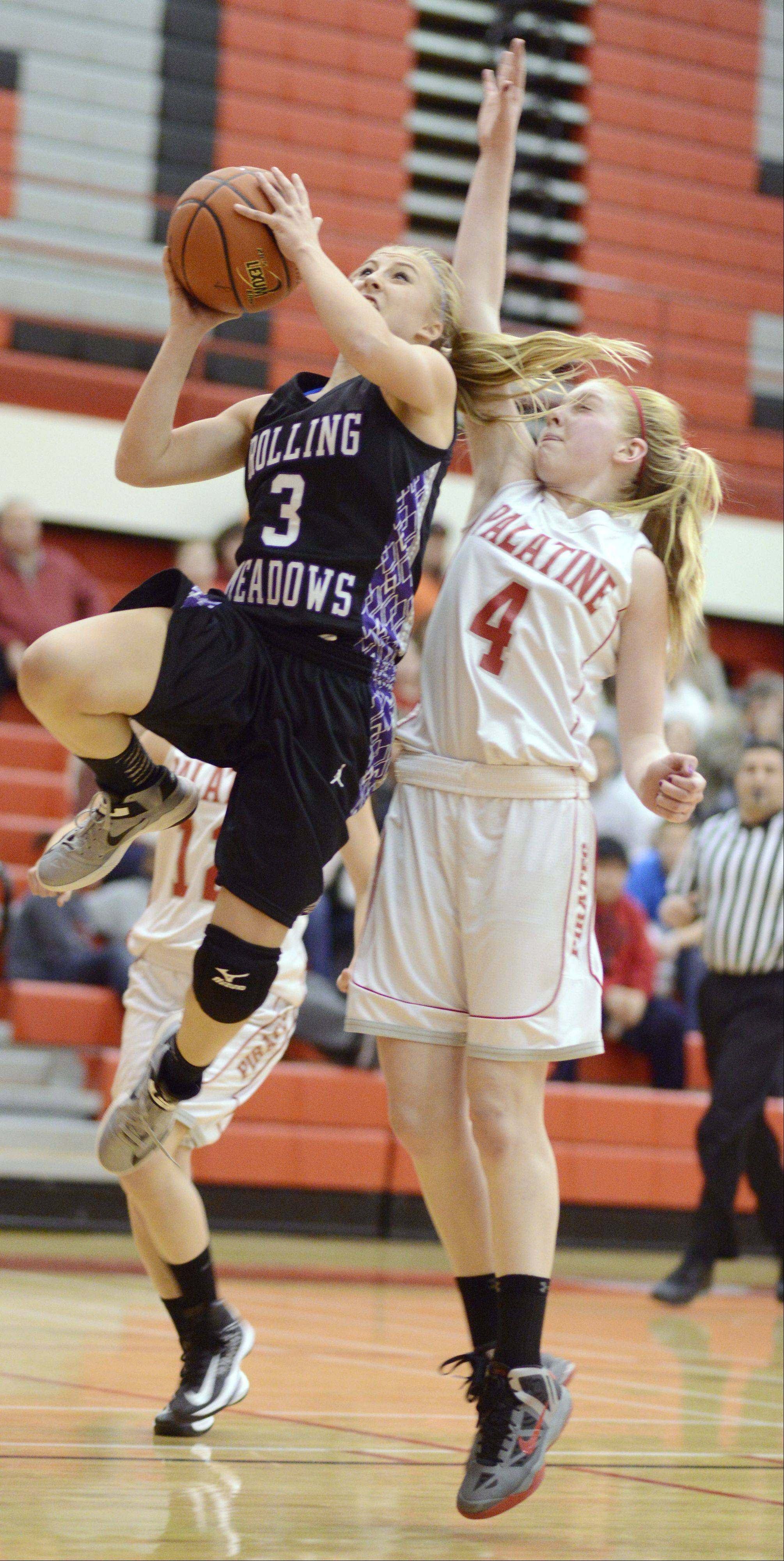 Rolling Meadows' Jackie Kemph stays a step ahead of Palatine's Morgan Radtke on a fastbreak during Wednesday's game.