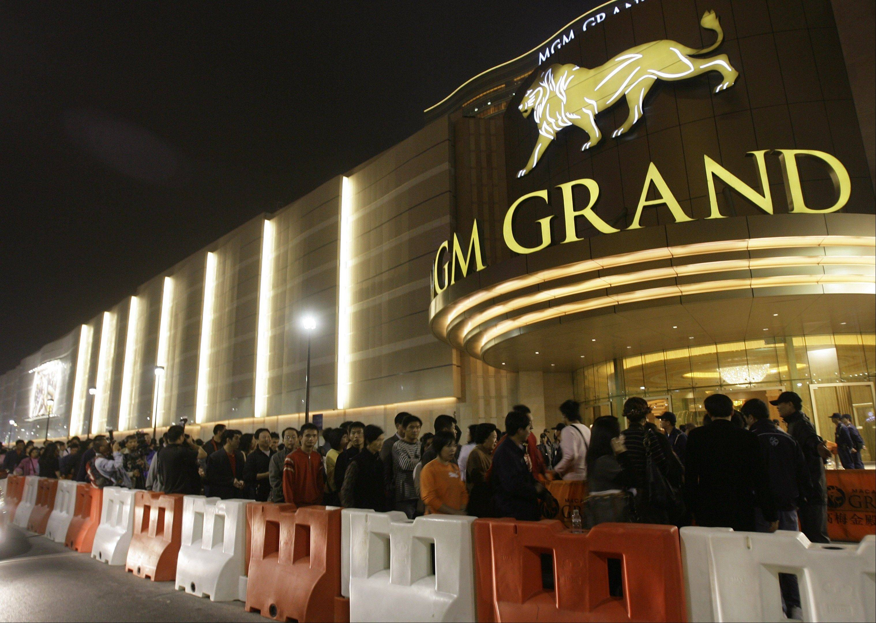 Visitors queue up to enter the new MGM Grand Macau casino resort in 2007. The Chinese arm of U.S. casino company MGM Resorts International won official approval for its new casino-resort in the world's most lucrative gambling market, Macau.