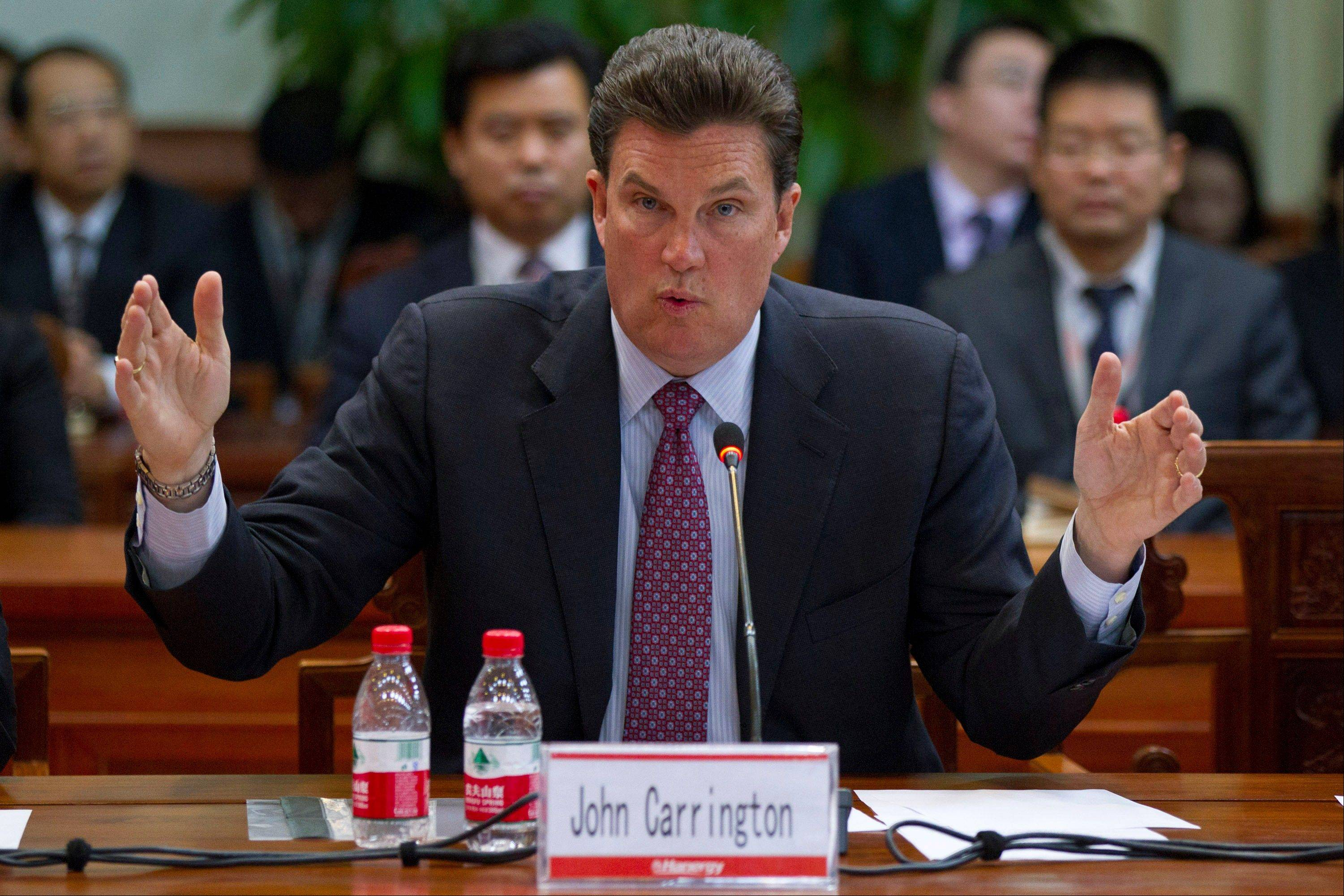 CEO of MiaSole John Carrignton speaks Wednesday during a news conference held at the headquarters of Hanergy Group in Beijing, China.