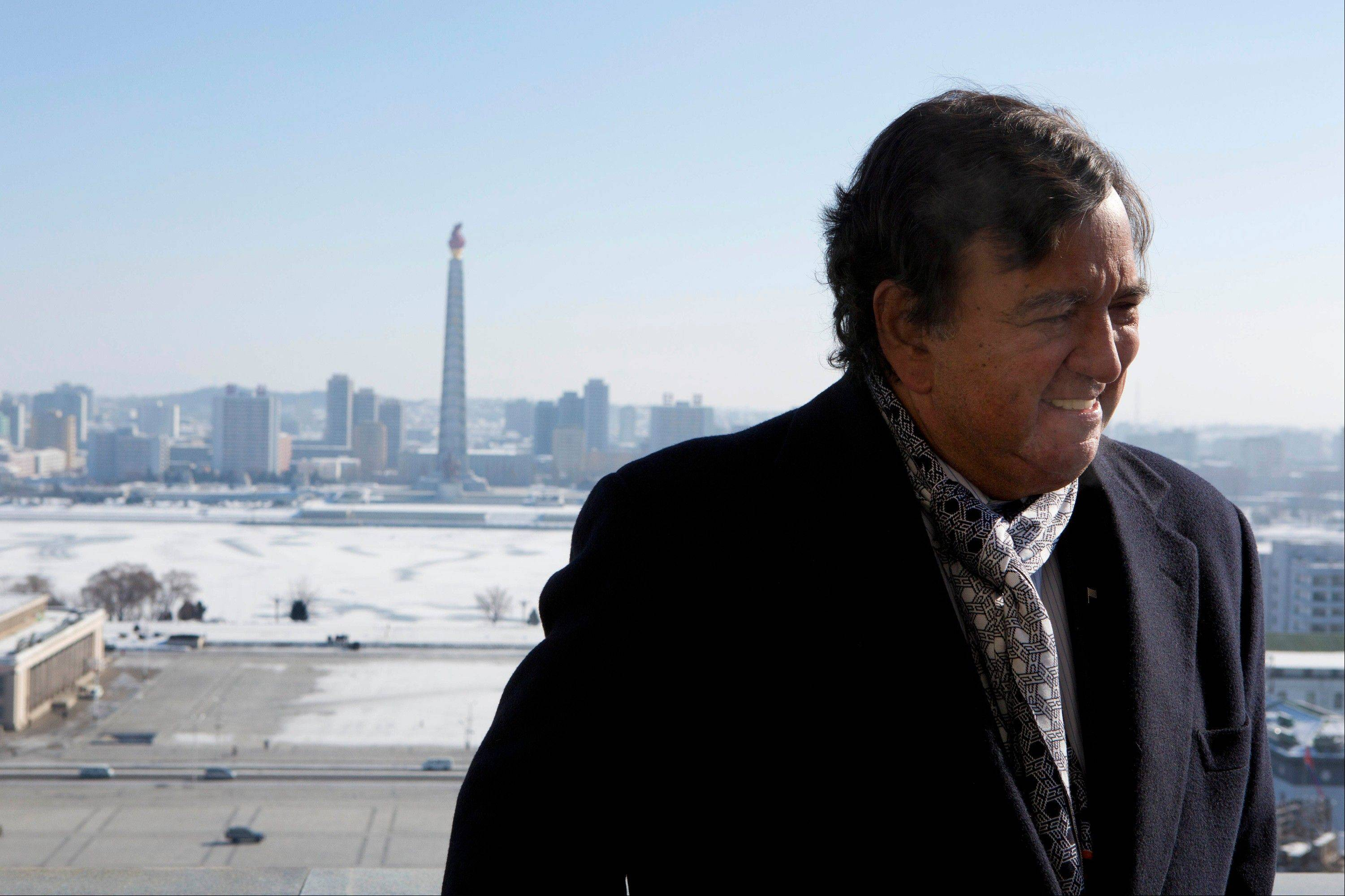 Former New Mexico Bill Richardson stands Wednesday on a balcony at the Grand Peoples Study House overlooking Juche Tower in Pyongyang, North Korea. Richardson said Wednesday that his delegation is pressing North Korea to put a moratorium on missile launches and nuclear tests and to allow more cellphones and an open Internet for its citizens.