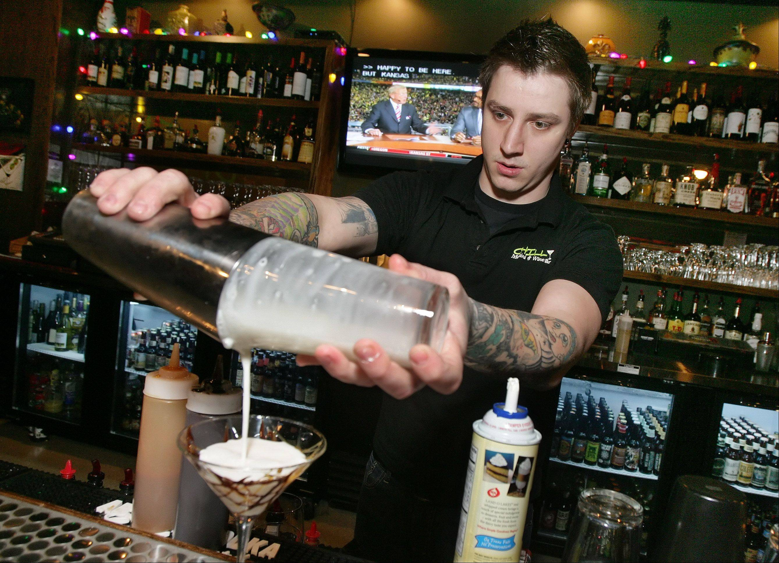Bartender Dave Lacchei mixes a martini at Chill Martini & Wine Bar in Lake Villa.