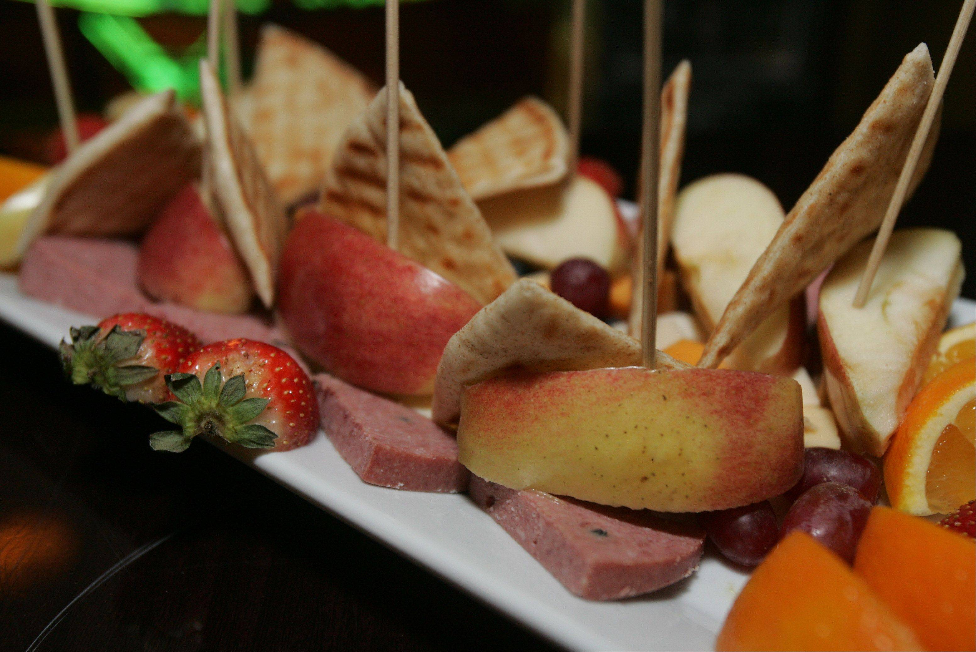 You can enjoy light snacks -- like the fruit, cheese and sausage platter -- with your drinks at Chill Martini & Wine Bar in Lake Villa.