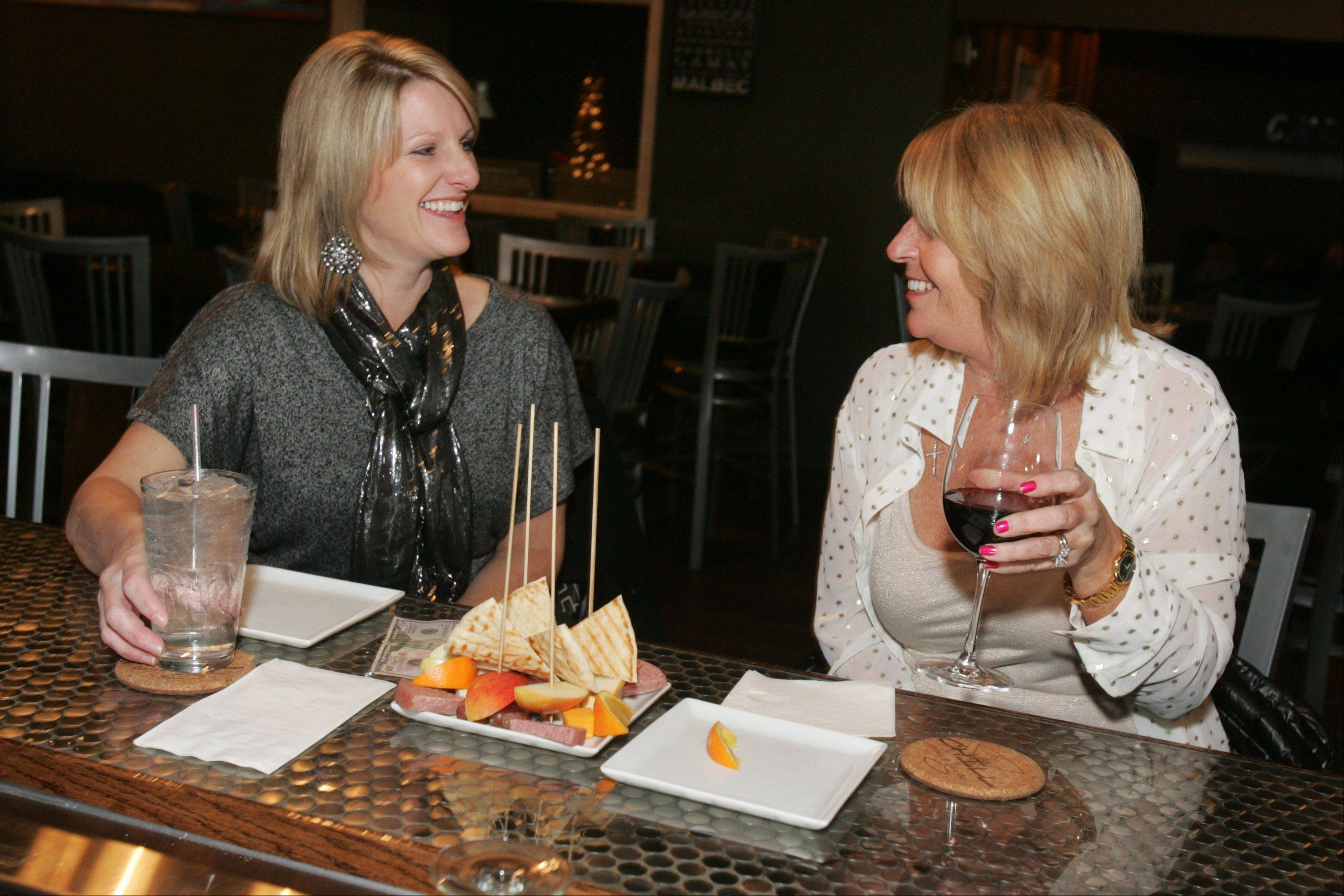 Pam Adams of Antioch, left, and Mary Martz of Trevor, Wisconsin, talk over drinks at Chill Martini & Wine Bar in Lake Villa.