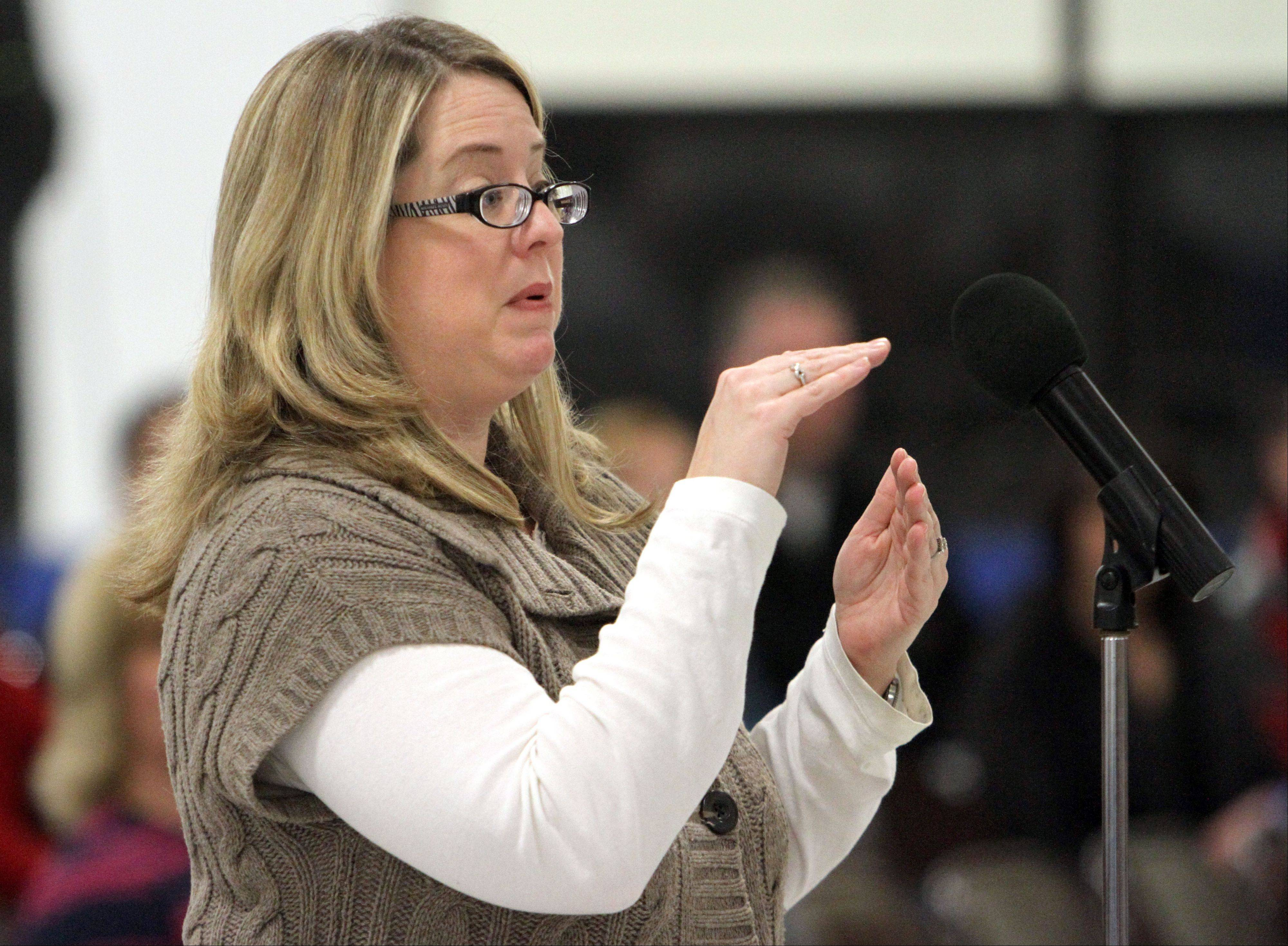 Sarah Watters of Grayslake asks questions during a town-hall meeting at Grayslake Middle School hosted by Grayslake Elementary District 46 Wednesday night. The meeting focused on issues related to a possible teachers strike.