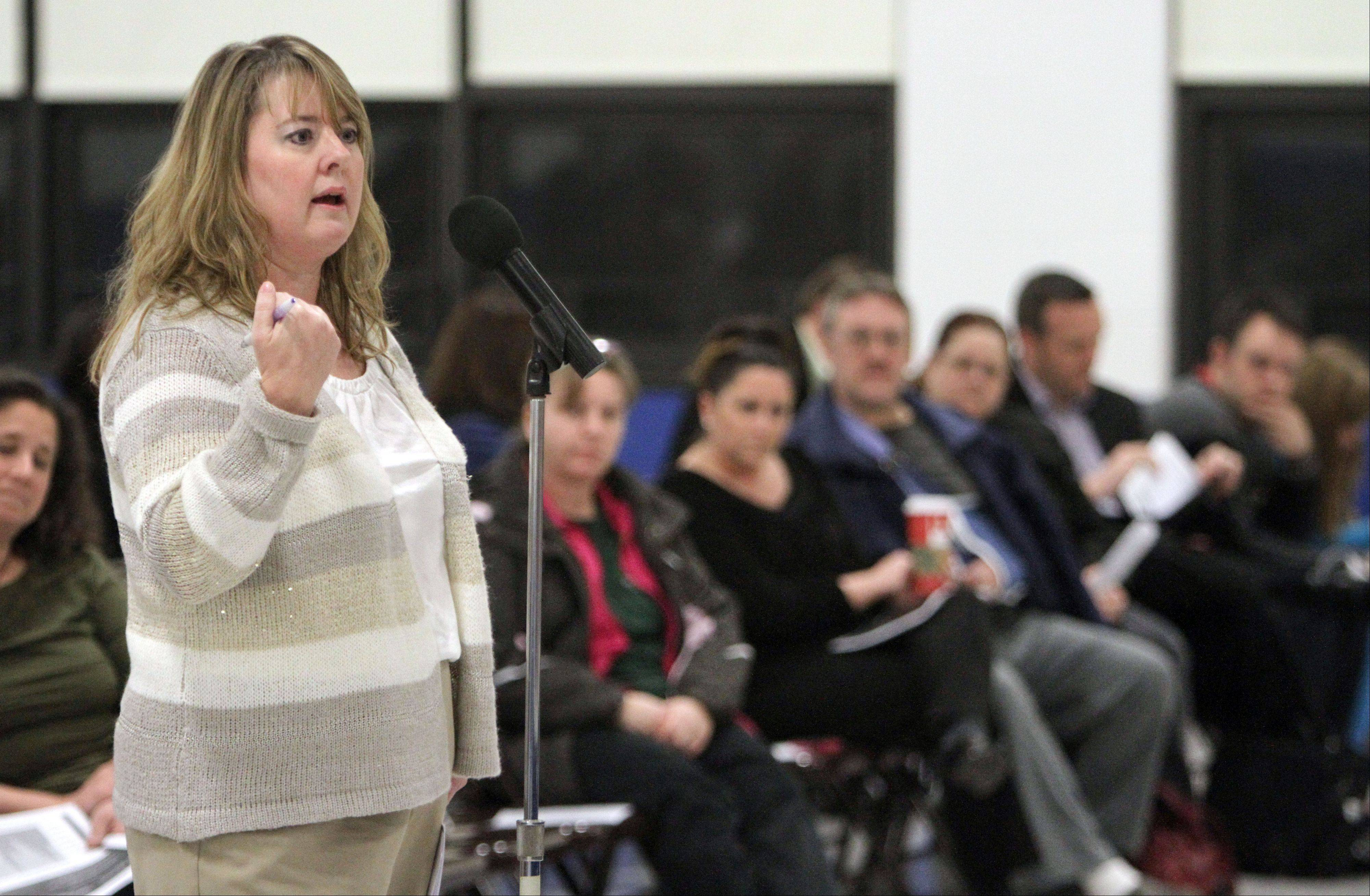 Colleen Wade, a Grayslake resident and mother of two, voices her concerns as Grayslake Elementary District 46 board members hosted a town-hall meeting Wednesday night to focus on questions from parents and others related to a possible teachers strike.