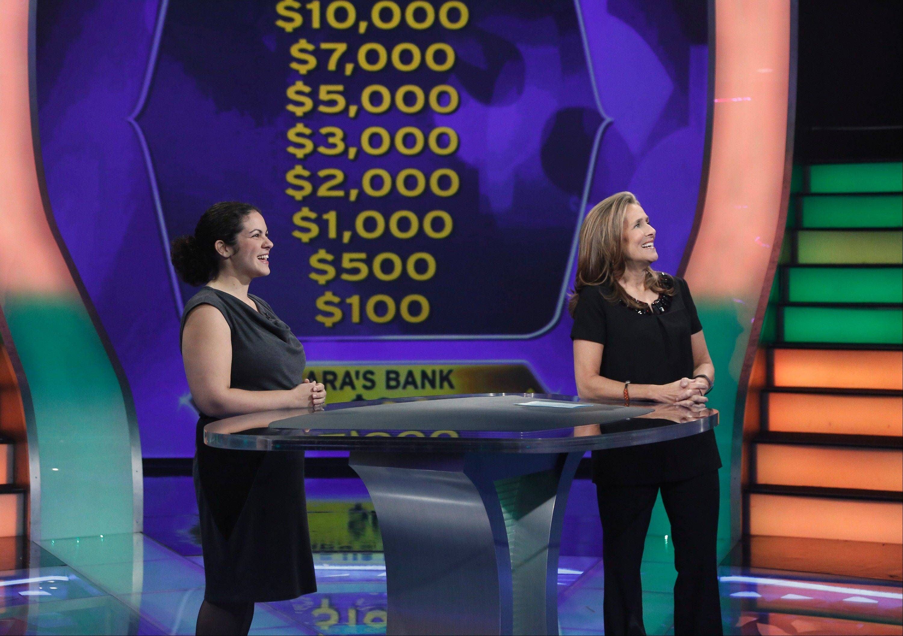 "Sara Hoskins of Bensenville is with host Meredith Vieira on ""Who Want To Be a Millionaire."""