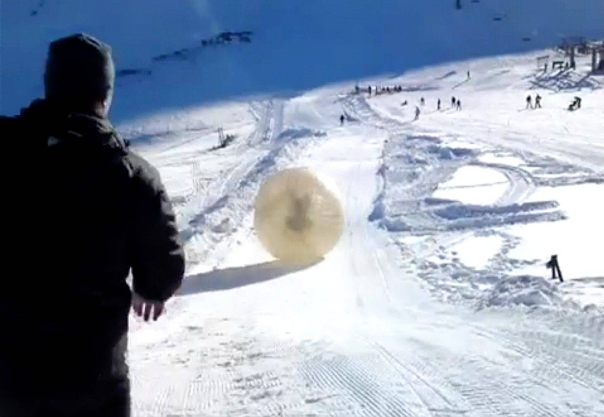 What was supposed to be a thrilling ride down a Russian ski slope inside a giant inflatable ball has ended in tragedy when the zorb veered off course and sailed over a cliff, killing Denis Burakov and leaving another man badly injured.