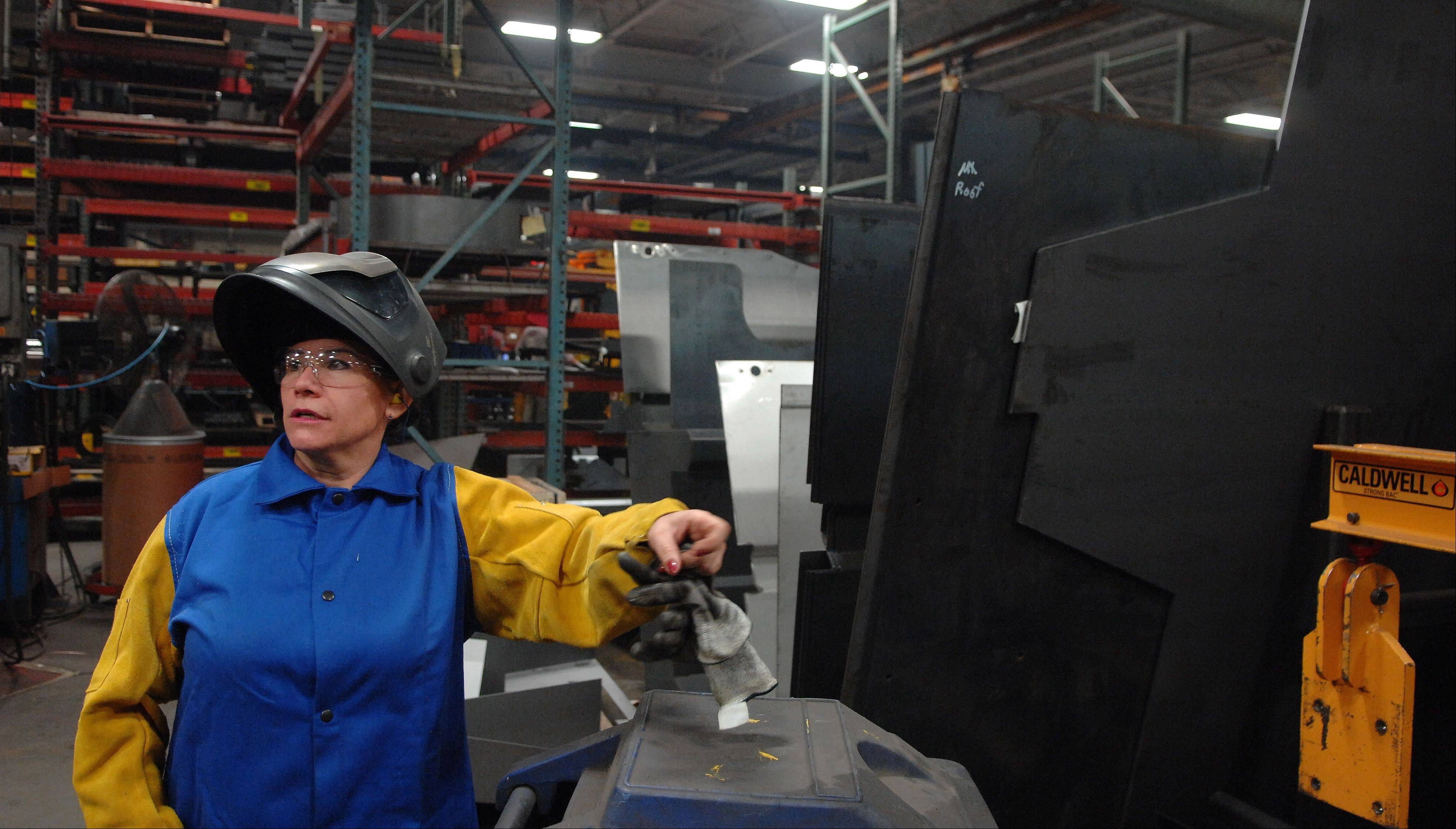 Juana Rodriguez is one of three female welders among 200 at Elgin Sweeper. She and a female co-worker were trained through an Elgin Community College program.
