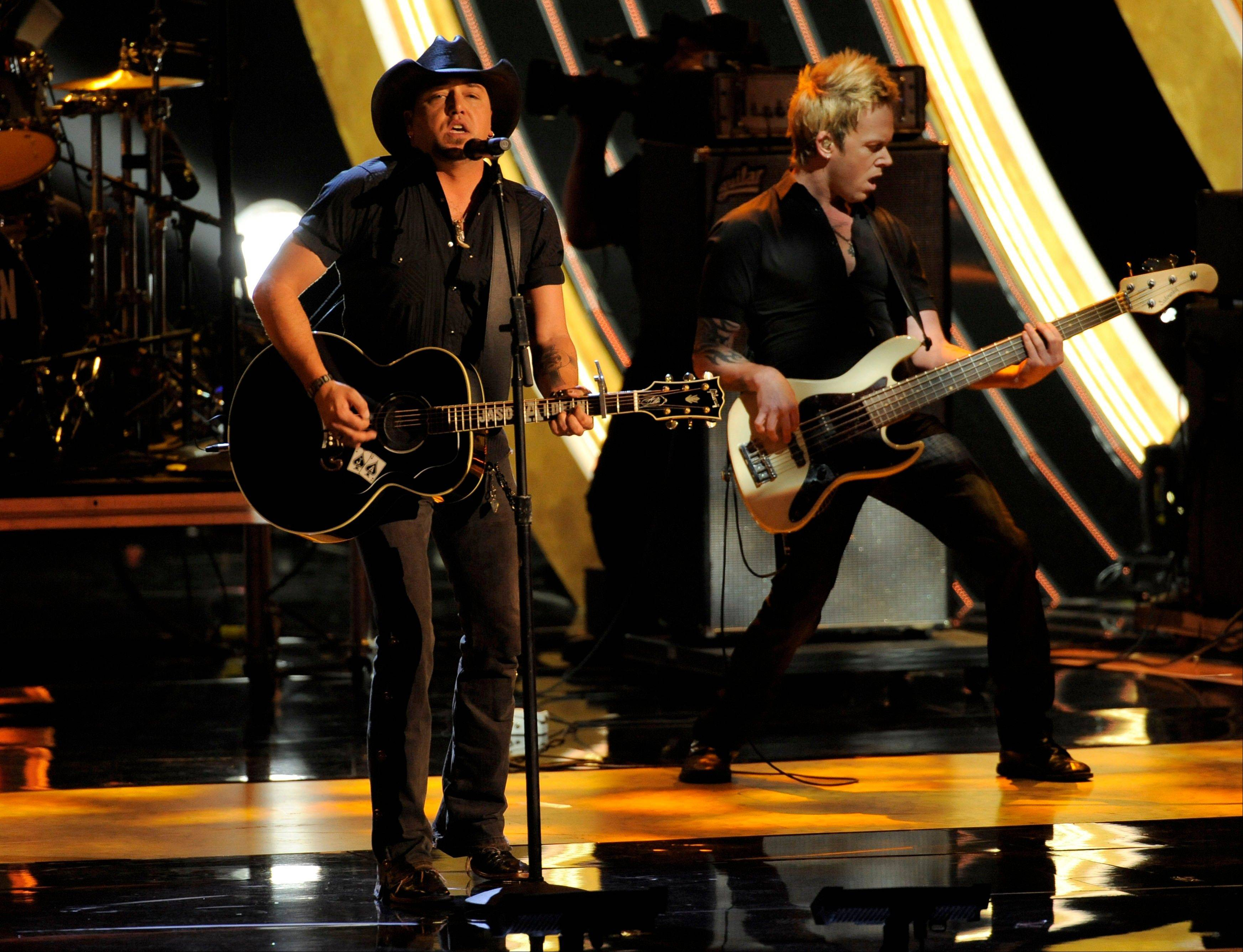 Jason Aldean, left, performs at the People's Choice Awards at the Nokia Theatre on Wednesday Jan. 9, 2013, in Los Angeles.