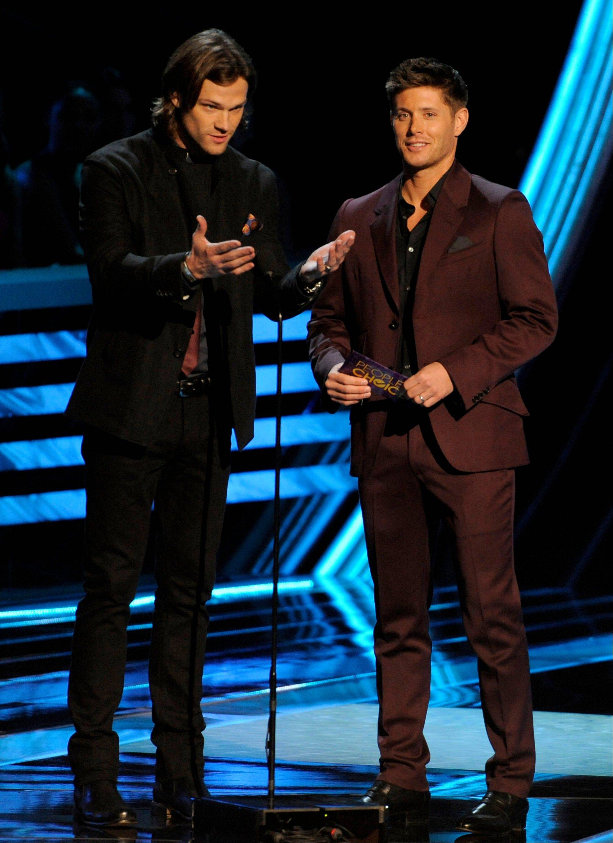 Jared Padalecki, left, and Jensen Ackles present the award for favorite band at the People's Choice Awards at the Nokia Theatre on Wednesday Jan. 9, 2013, in Los Angeles.
