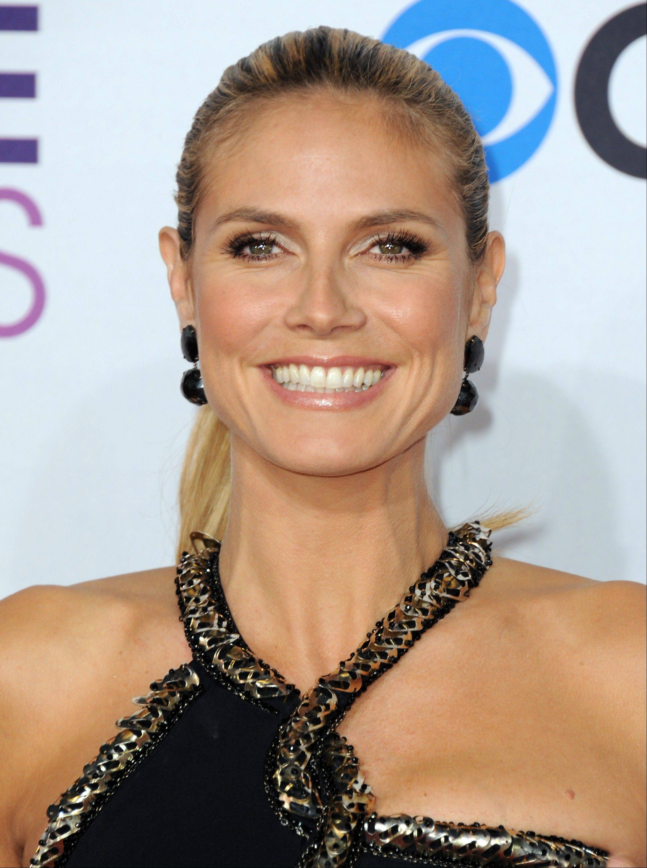 Heidi Klum arrives at the People's Choice Awards at the Nokia Theatre on Wednesday Jan. 9, 2013, in Los Angeles.