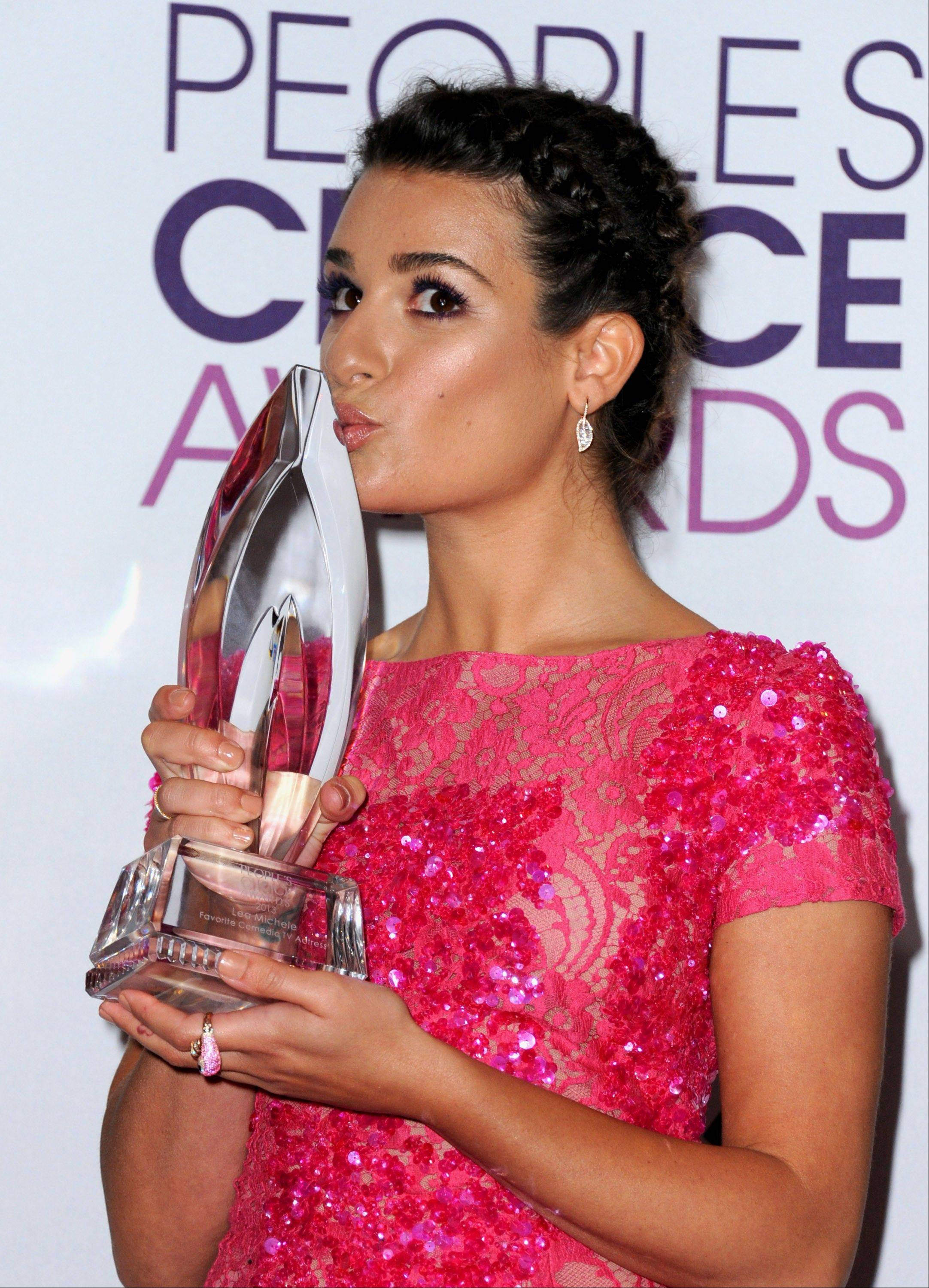 Lea Michele poses backstage with the award for favorite comedic TV actress at the People's Choice Awards at the Nokia Theatre on Wednesday Jan. 9, 2013, in Los Angeles. (Photo by Jordan Strauss/Invision/AP)