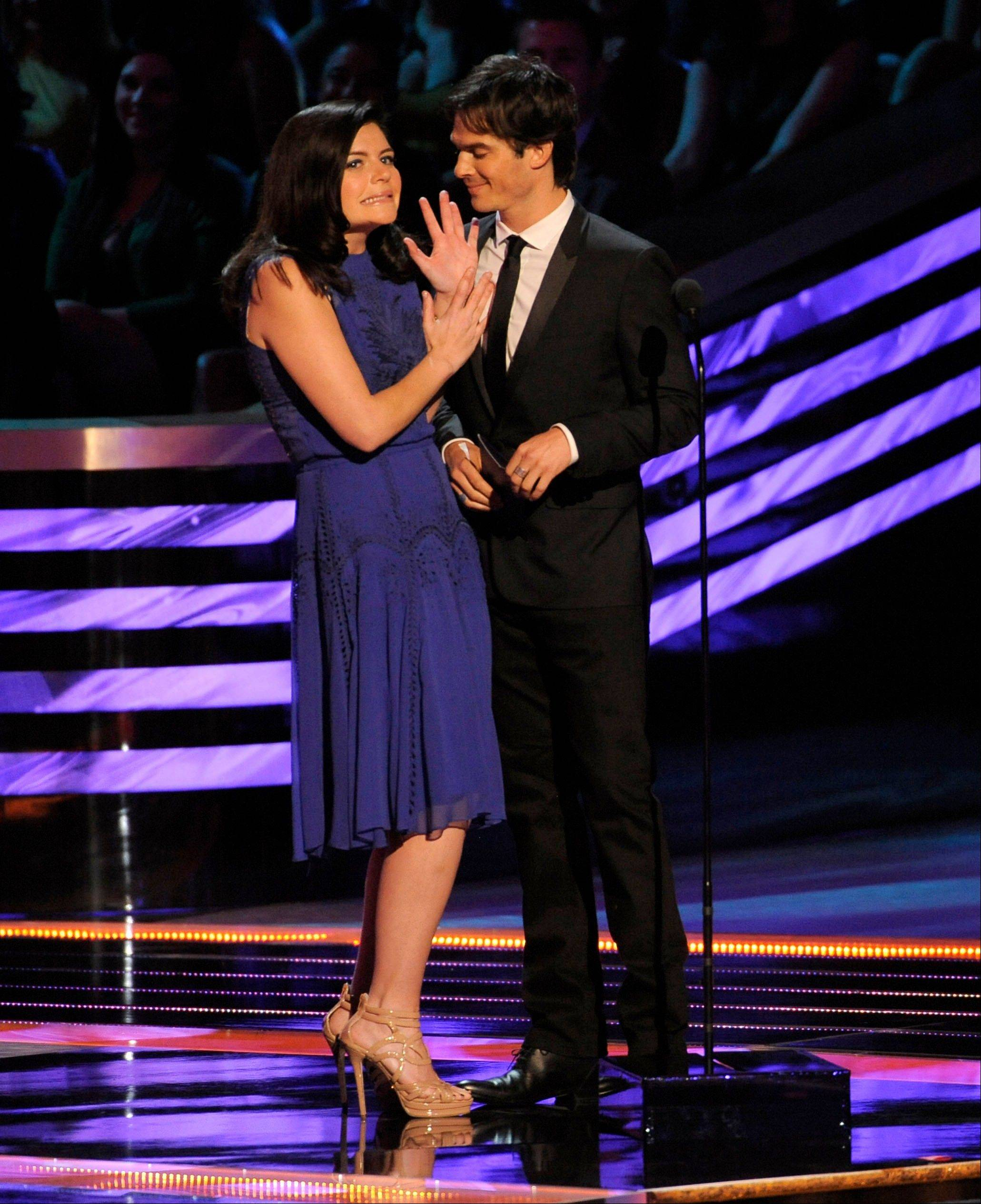 Casey Wilson, left, and Ian Somerhalder present the award for favorite comedic actor at the People's Choice Awards at the Nokia Theatre on Wednesday Jan. 9, 2013, in Los Angeles.