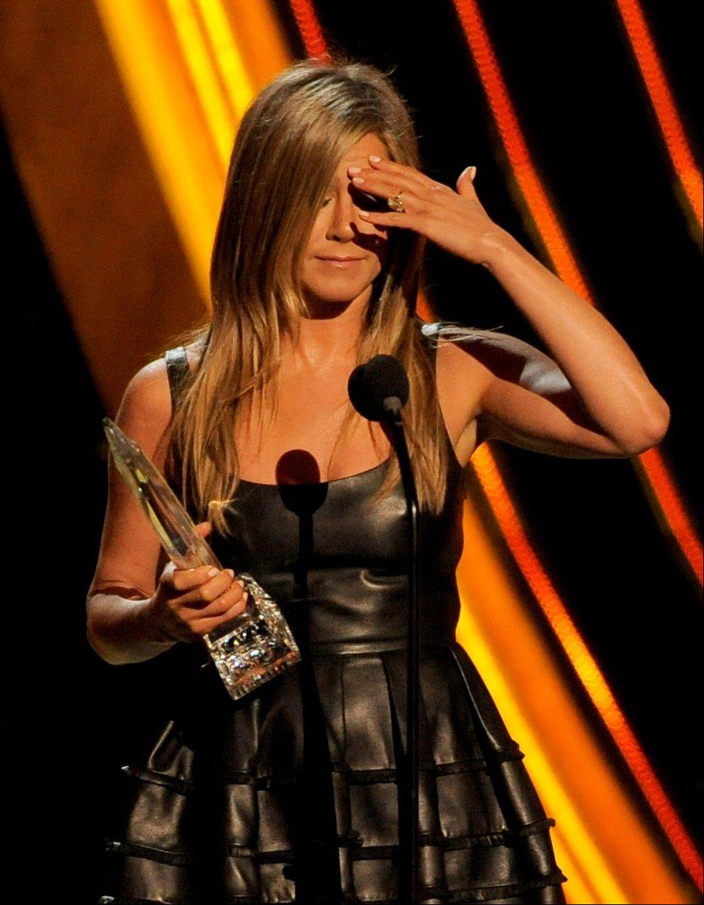 Jennifer Aniston accepts the award for favorite comedic movie actress at the People's Choice Awards at the Nokia Theatre on Wednesday Jan. 9, 2013, in Los Angeles.