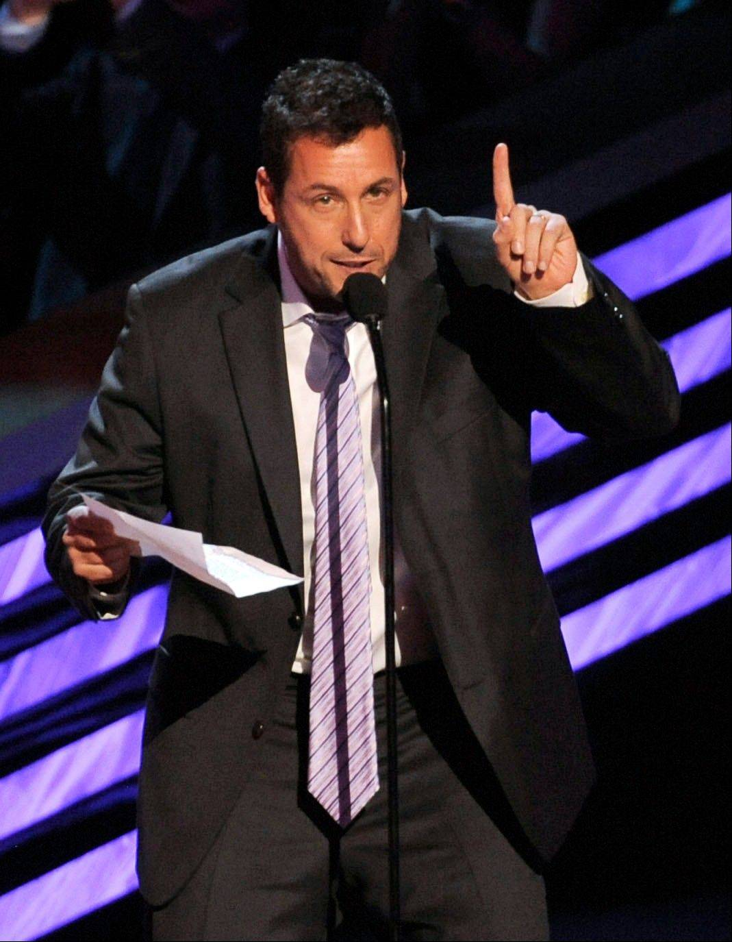 Adam Sandler accepts the award for favorite comedic actor at the People's Choice Awards at the Nokia Theatre on Wednesday Jan. 9, 2013, in Los Angeles.