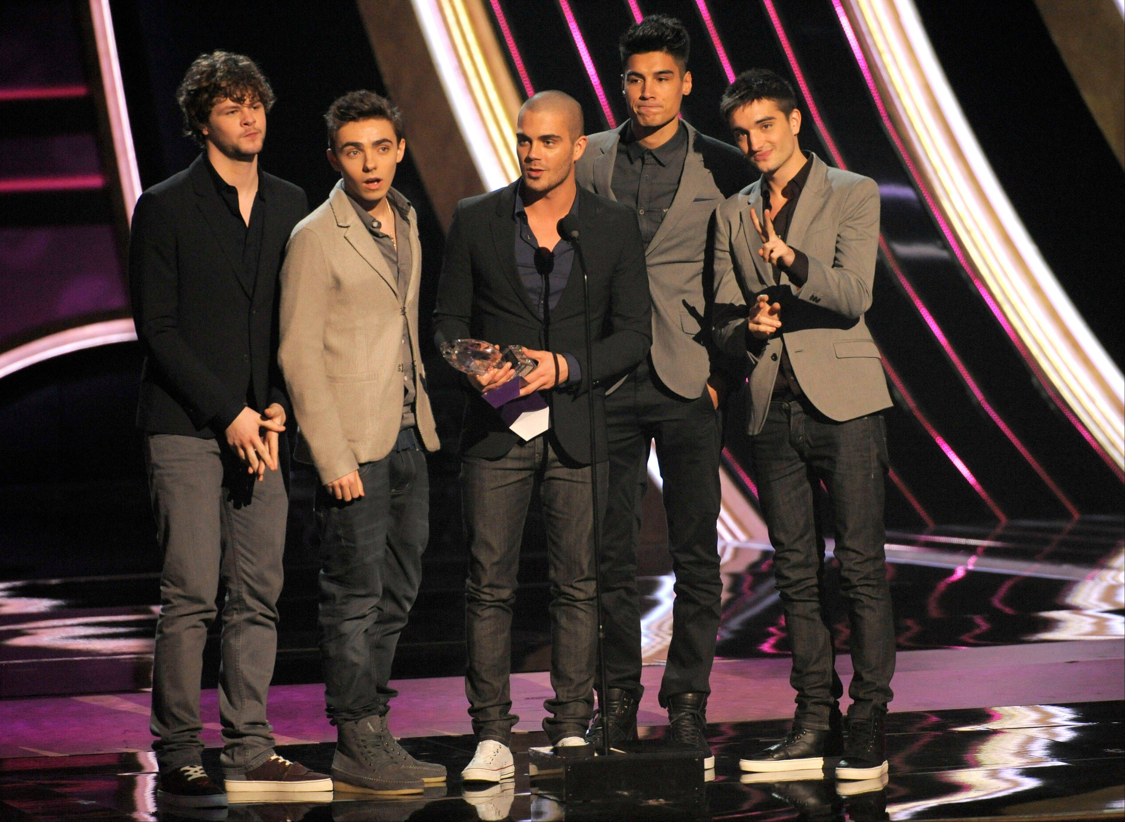 The Wanted accept the award for favorite Breakout artist at the People's Choice Awards at the Nokia Theatre on Wednesday Jan. 9, 2013, in Los Angeles.