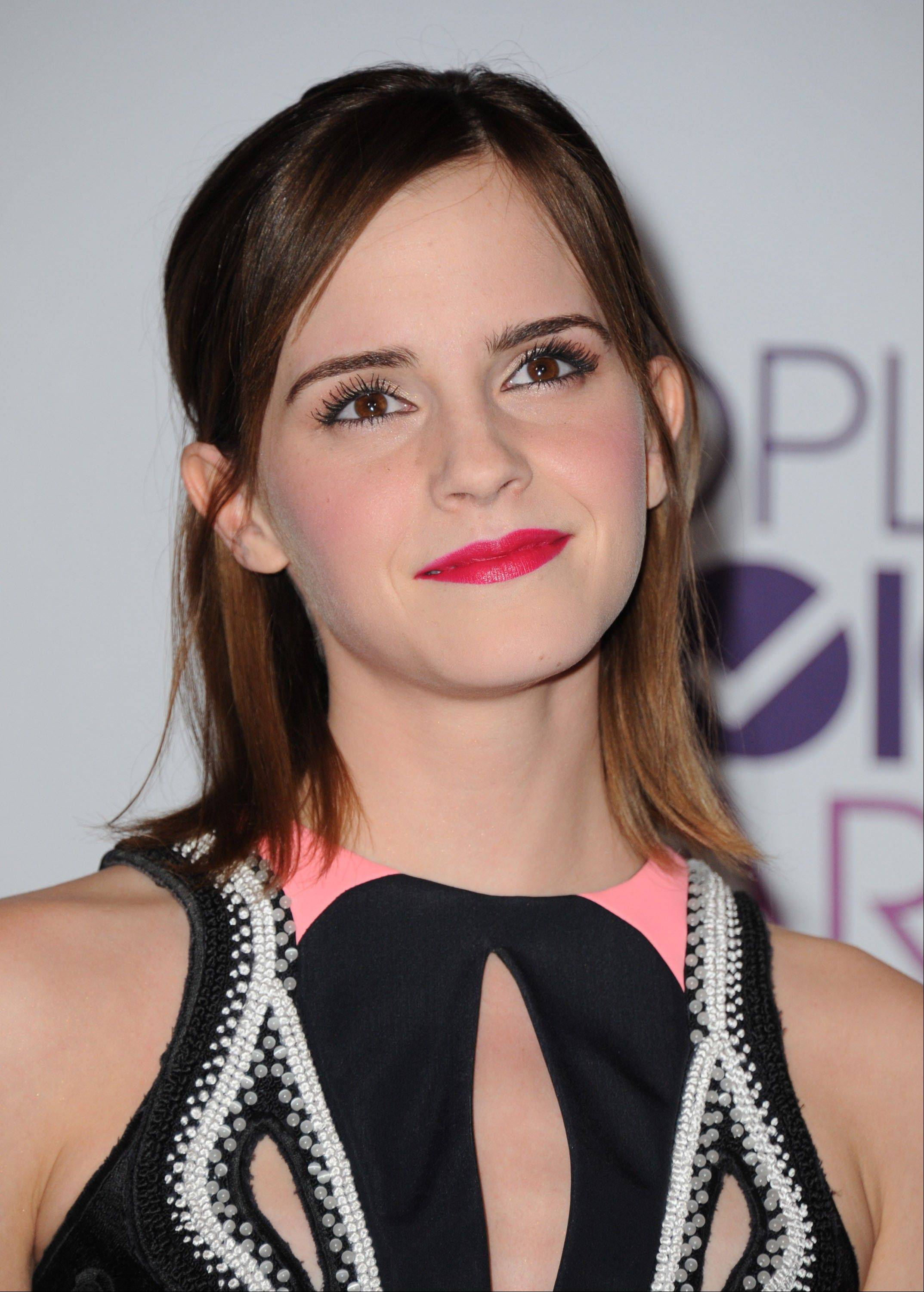 Emma Watson poses backstage with the award for favorite dramatic movie actress at the People's Choice Awards at the Nokia Theatre on Wednesday Jan. 9, 2013, in Los Angeles.