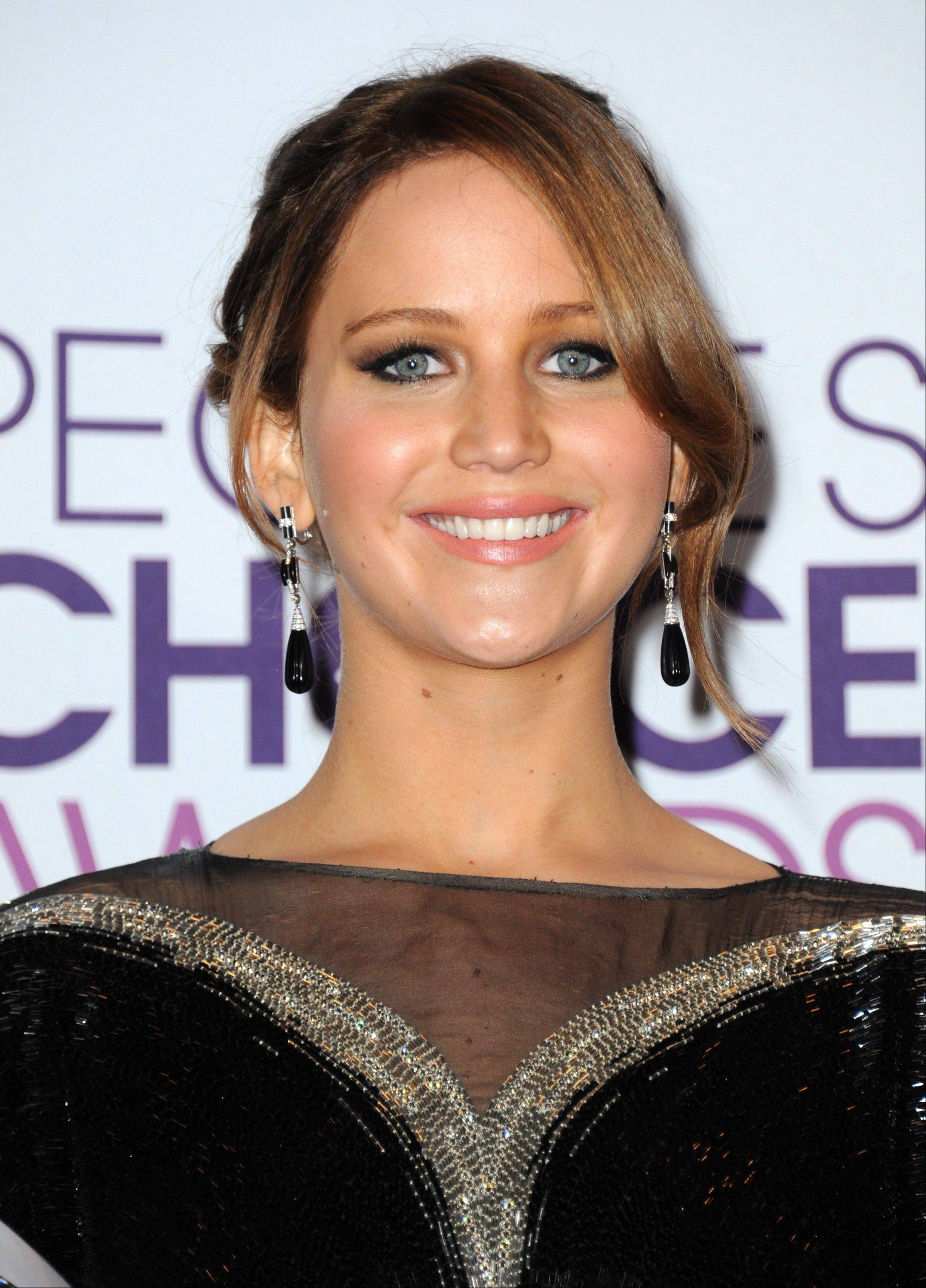 Jennifer Lawrence, winner of the award for favorite movie actress, poses backstage at the People's Choice Awards at the Nokia Theatre on Wednesday Jan. 9, 2013, in Los Angeles.
