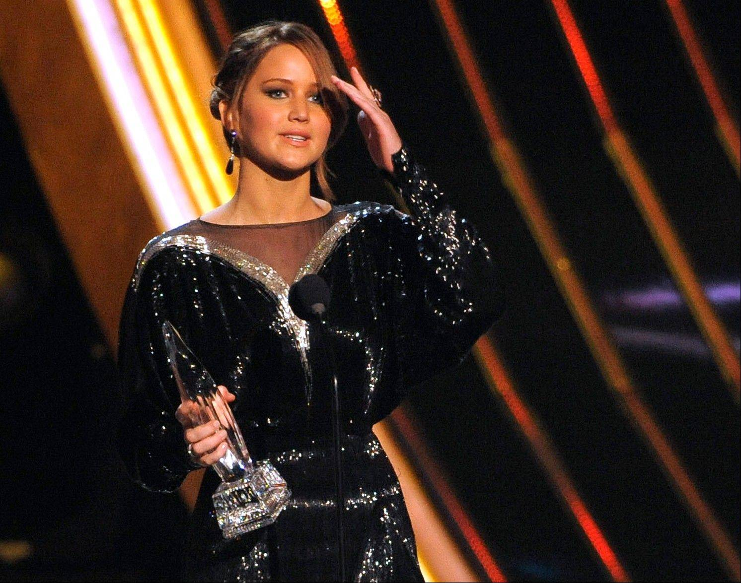 Jennifer Lawrence accepts the award for favorite movie actress at the People's Choice Awards at the Nokia Theatre on Wednesday Jan. 9, 2013, in Los Angeles.